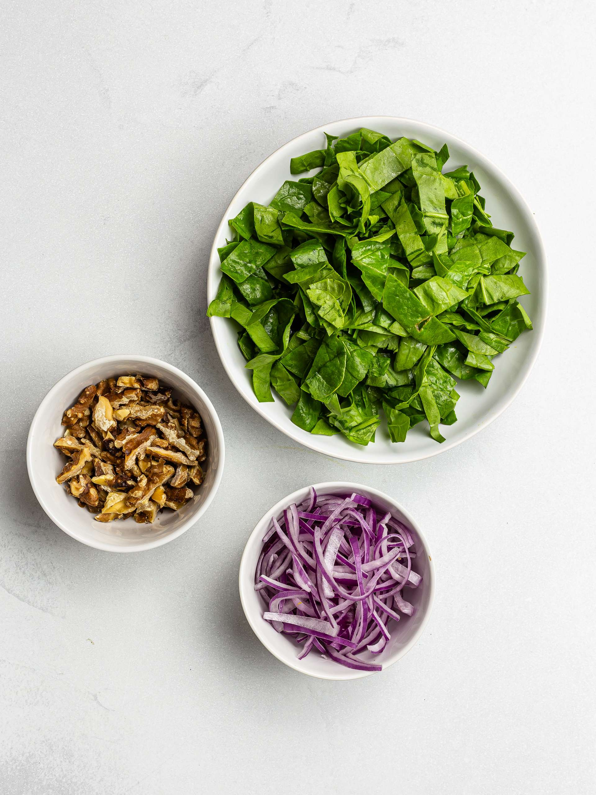 chopped spinach, onions, and walnuts