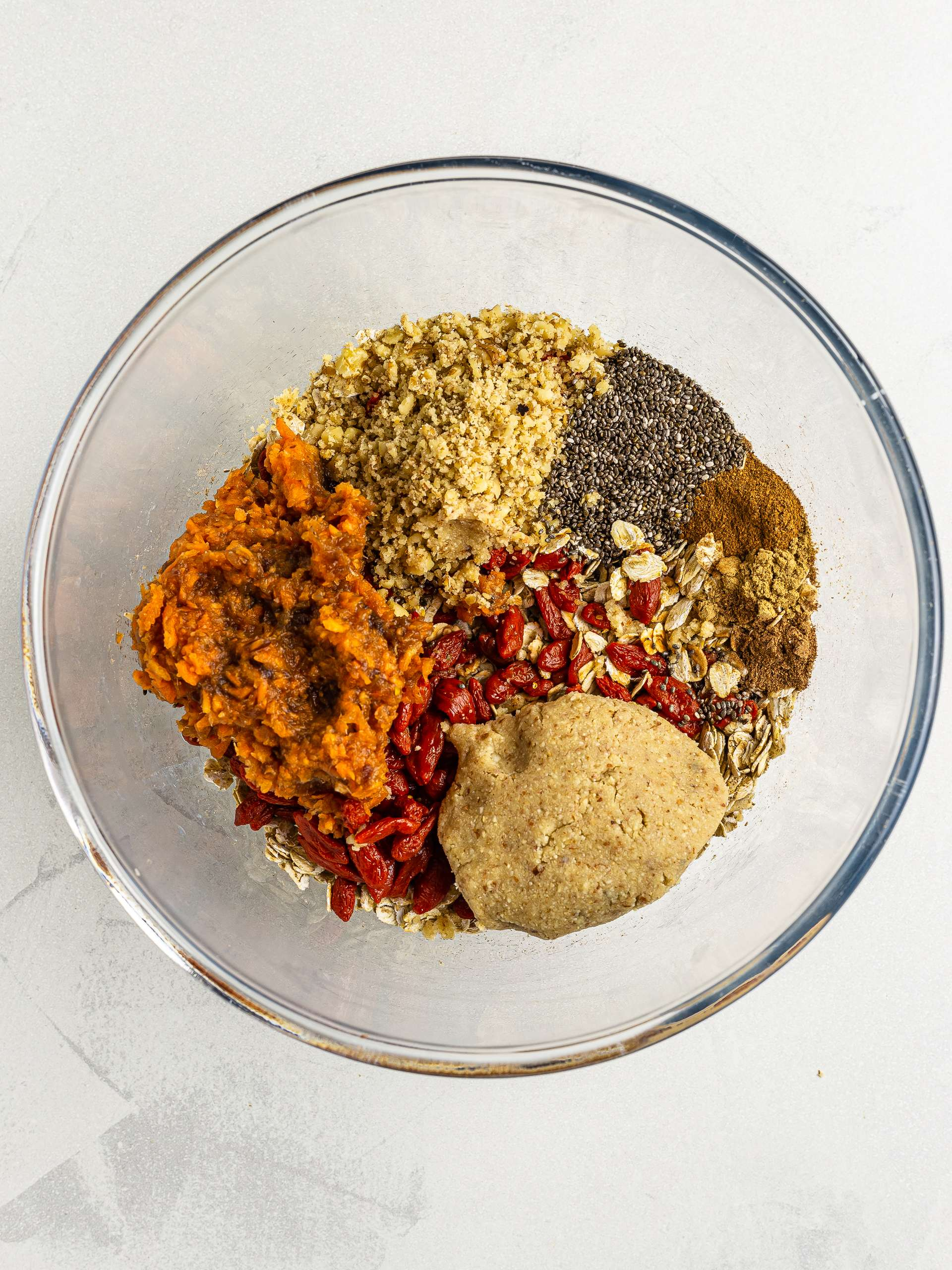 carrot cake energy balls ingredients in a bowl