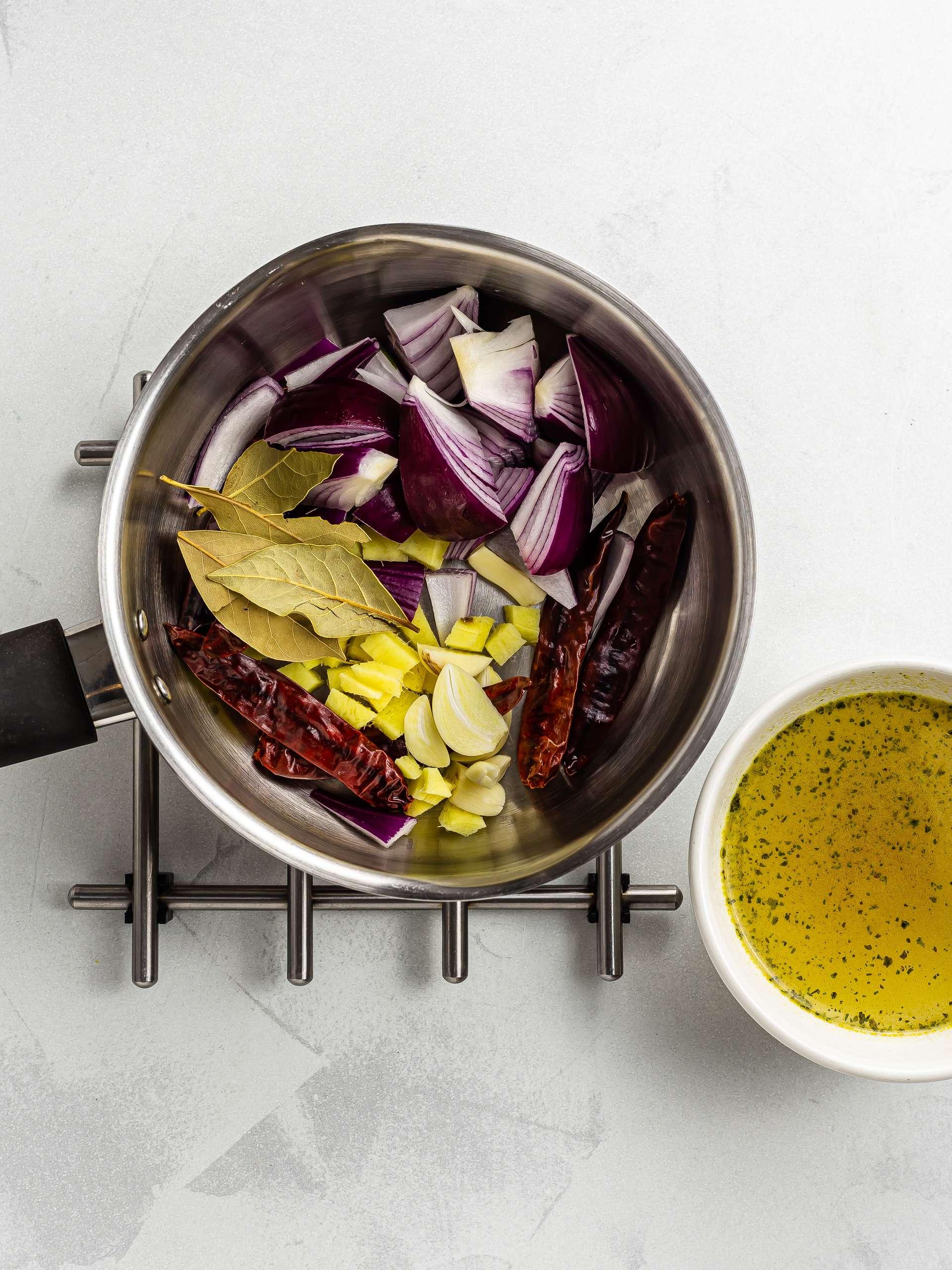 vegan adobo broth ingredients in a pot