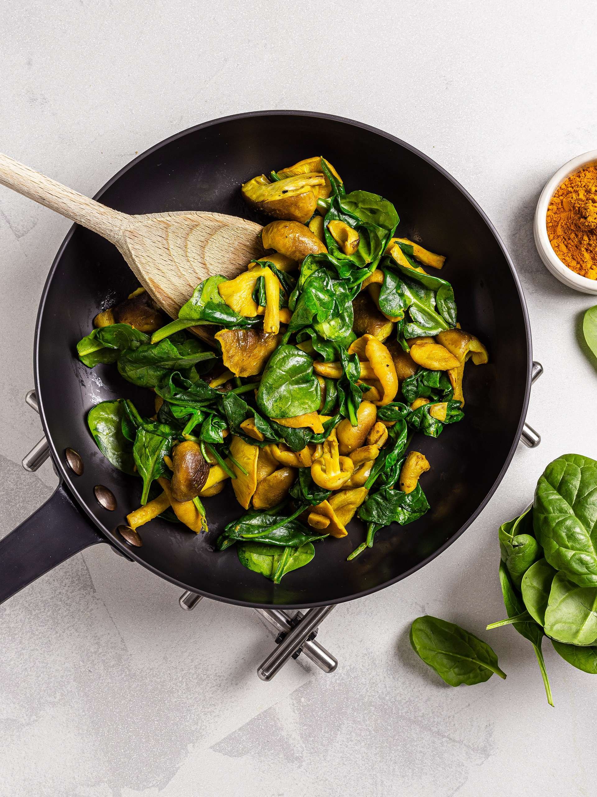 Cooked spinach and mushrooms with turmeric
