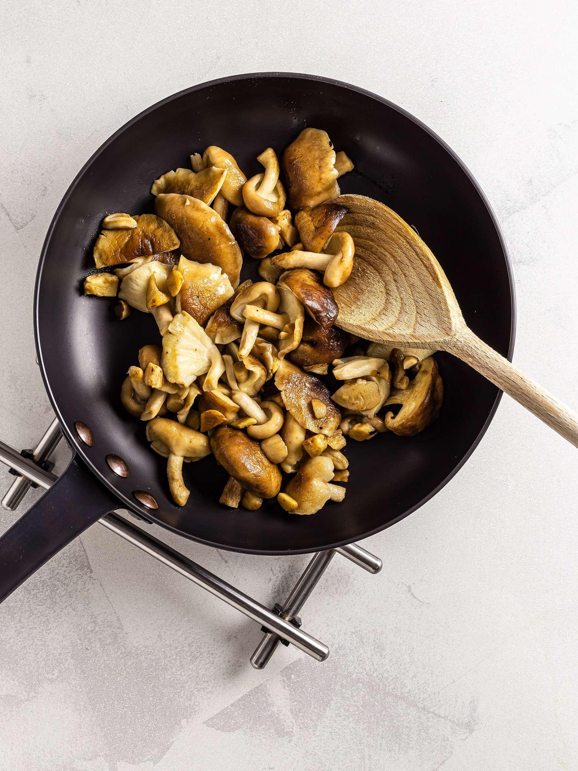 Sautéed shiitake mushrooms in a skillet