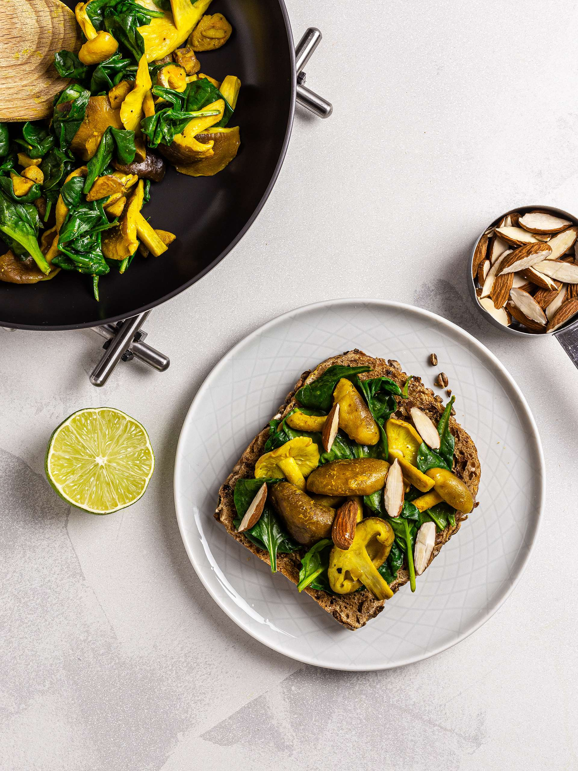 Sourdough toast with spinach, mushrooms and almonds