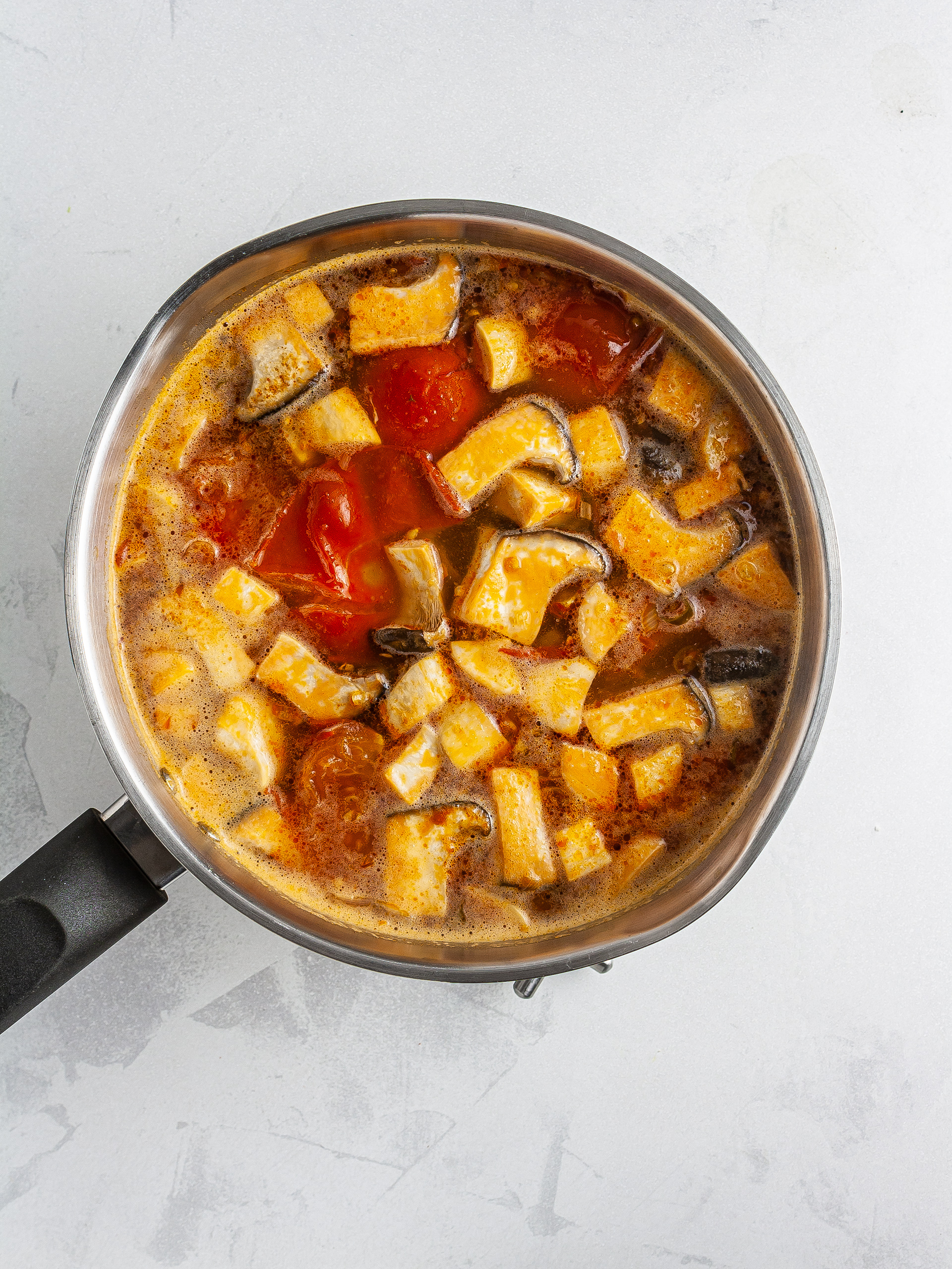 Tomatoes and mushroom in fish stock
