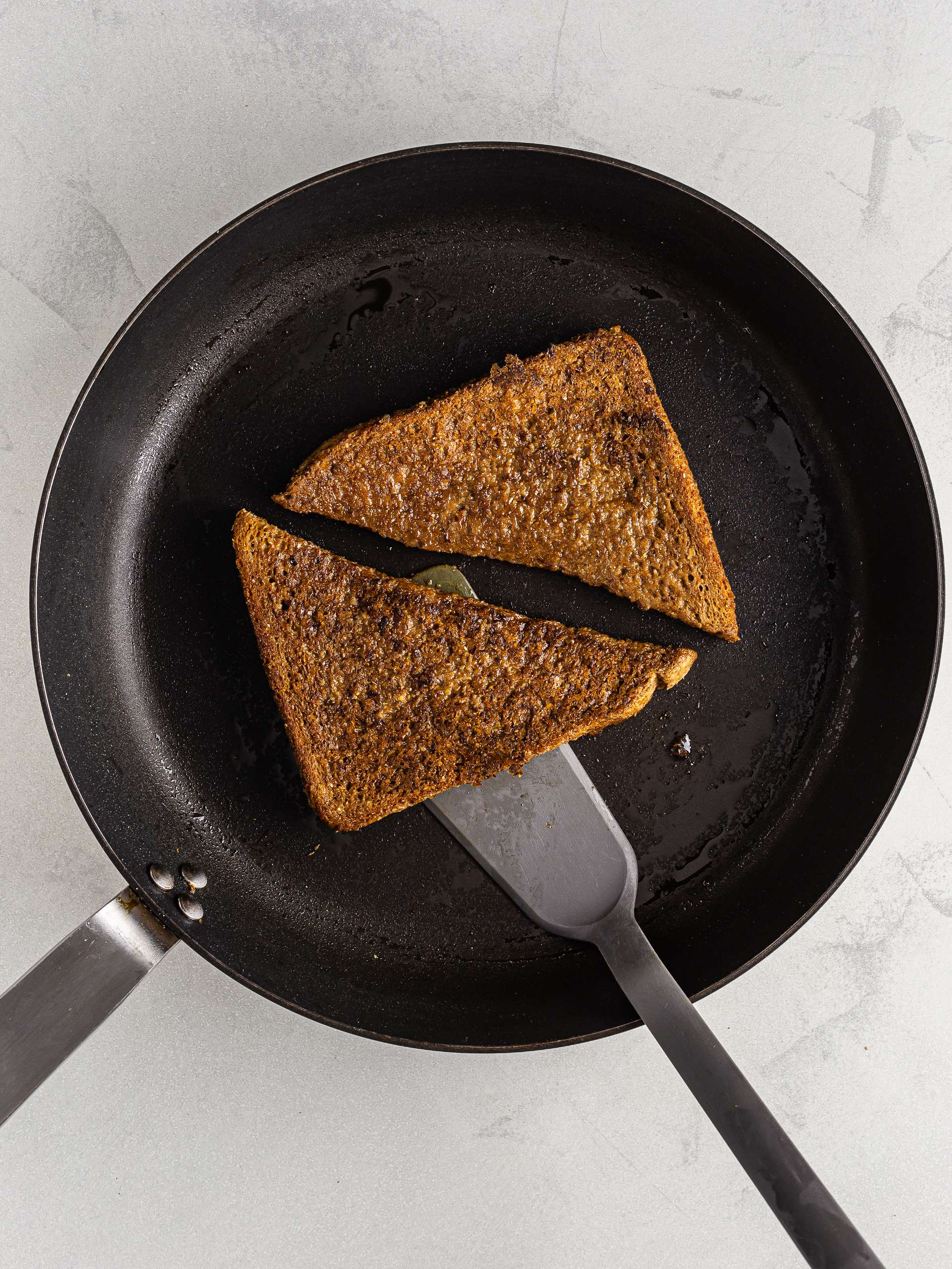 vegan coffee french toast cooked in a skillet