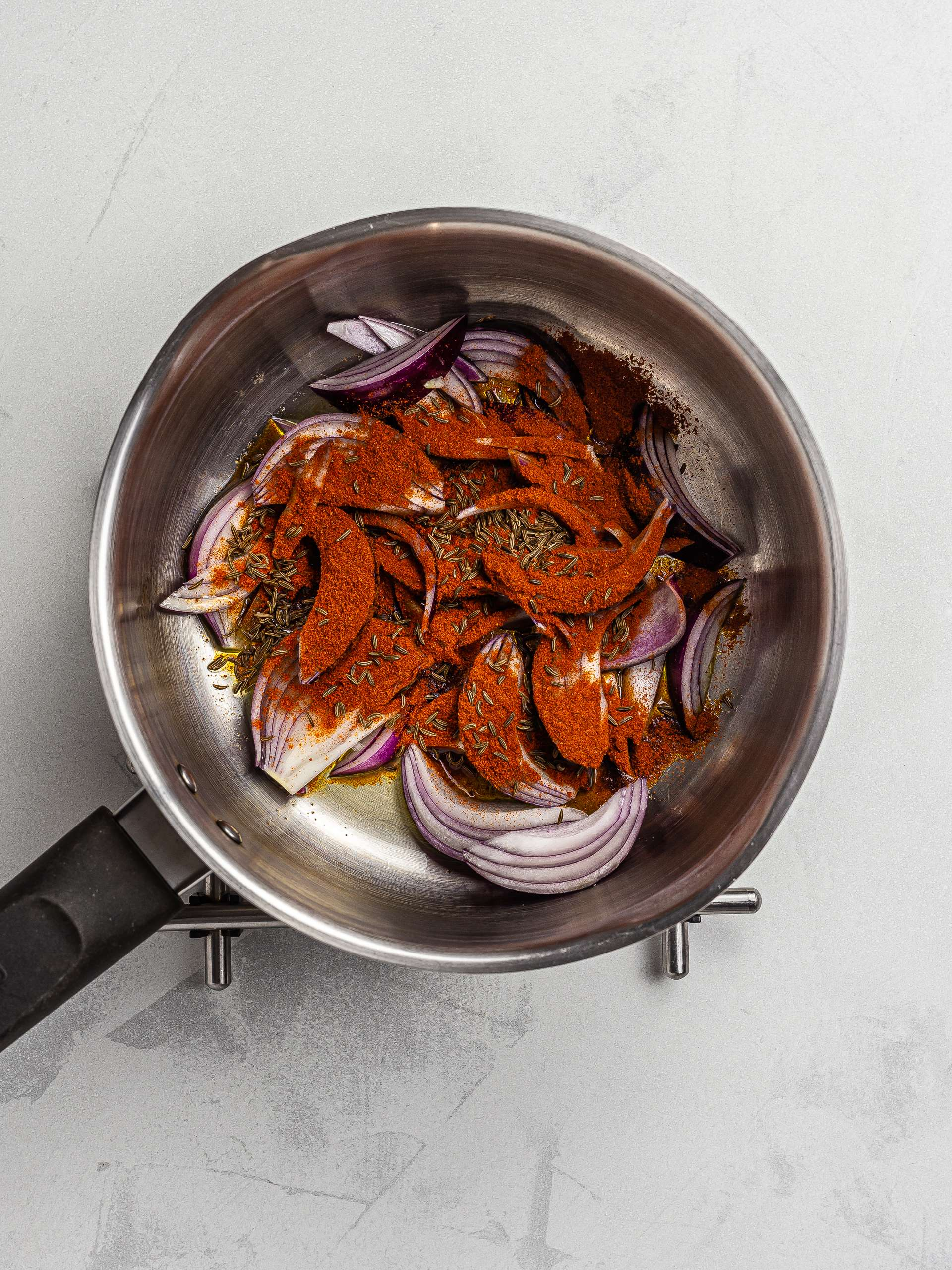 onions, paprika, and caraway seeds for goulash