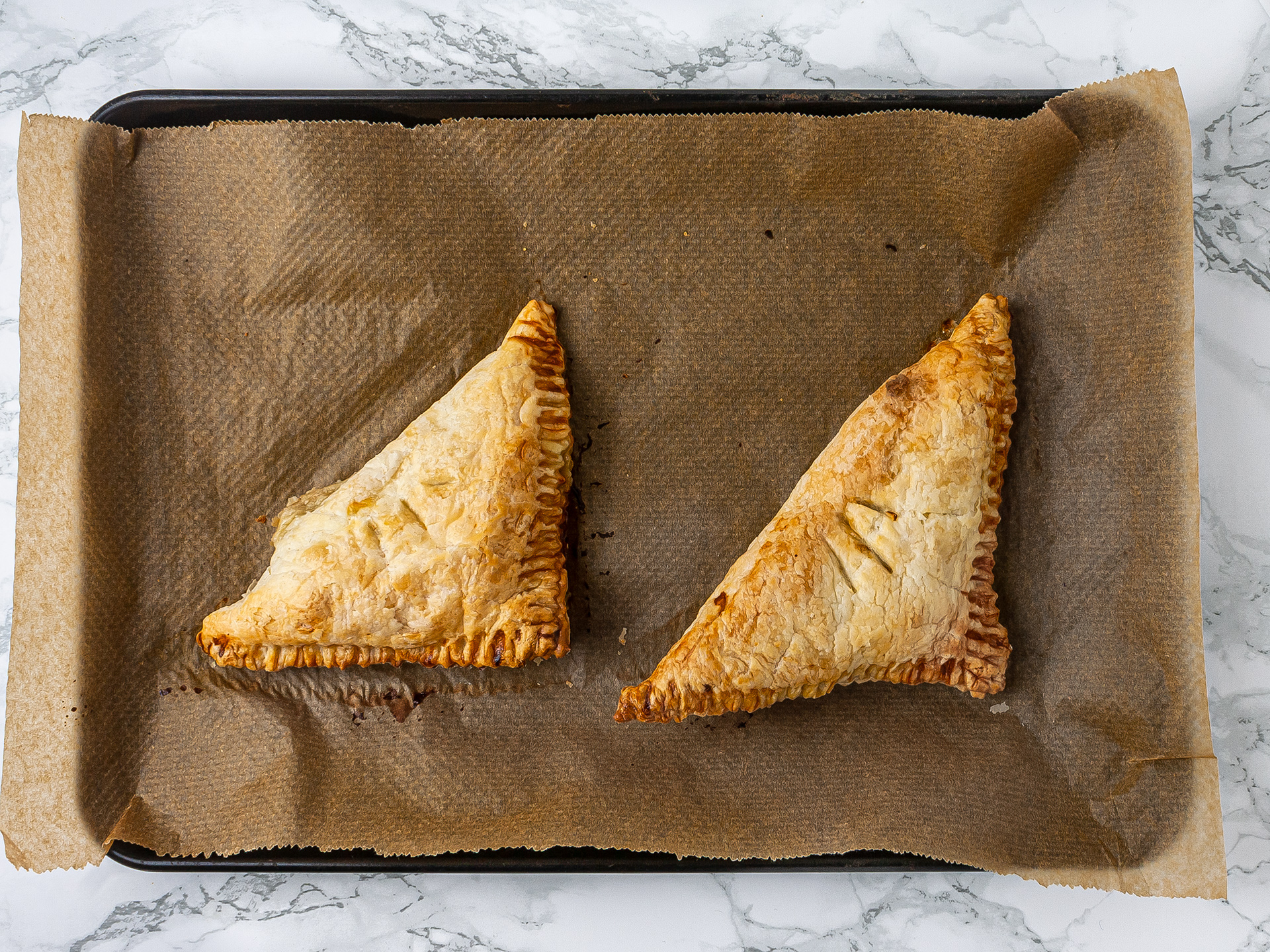Crispy gluten-free pear turnover with dates pastries baked in the oven