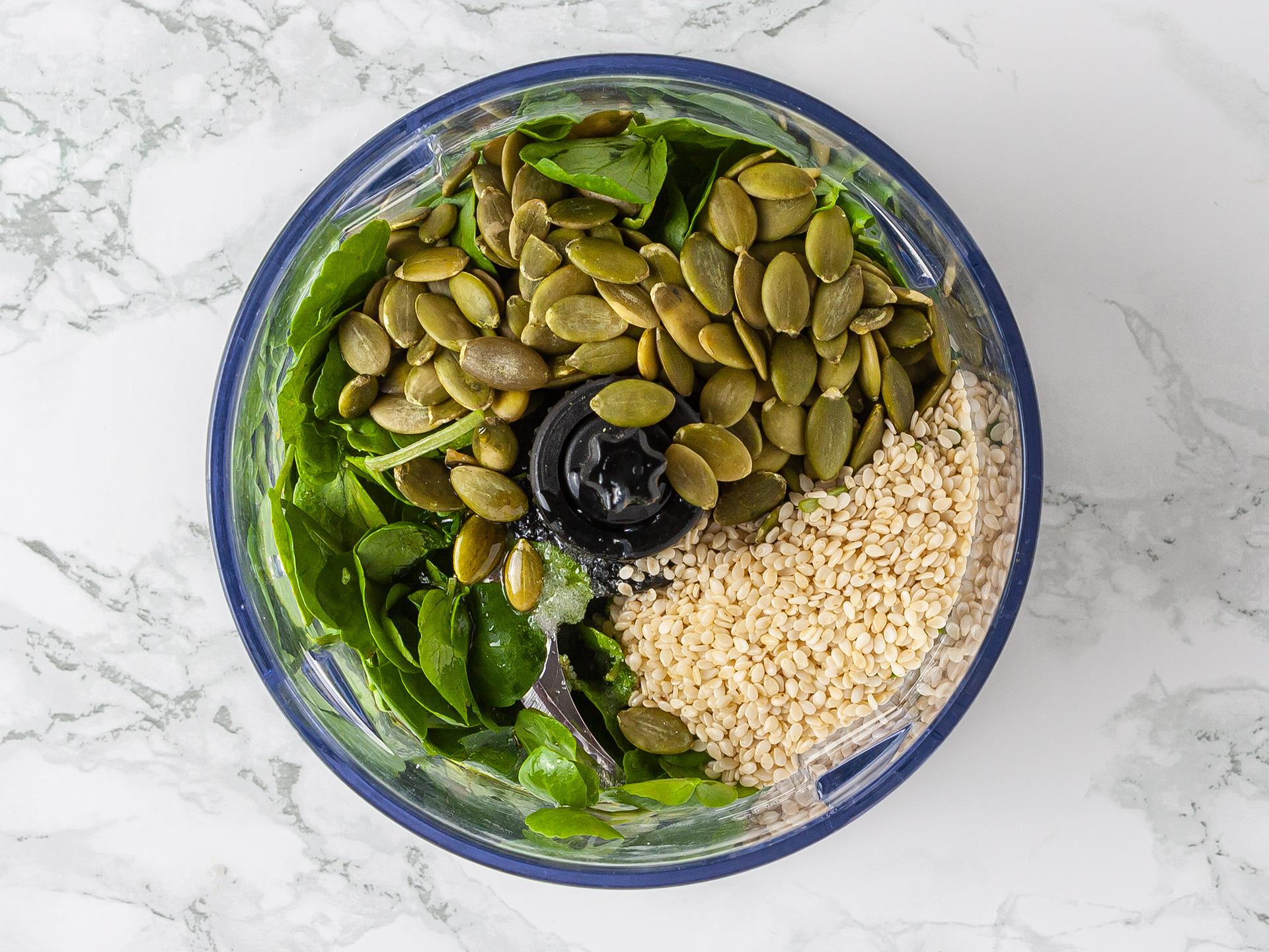 watercress, sunflower seeds, sesame seeds, lemon juice, and oil in a food processor to make pesto