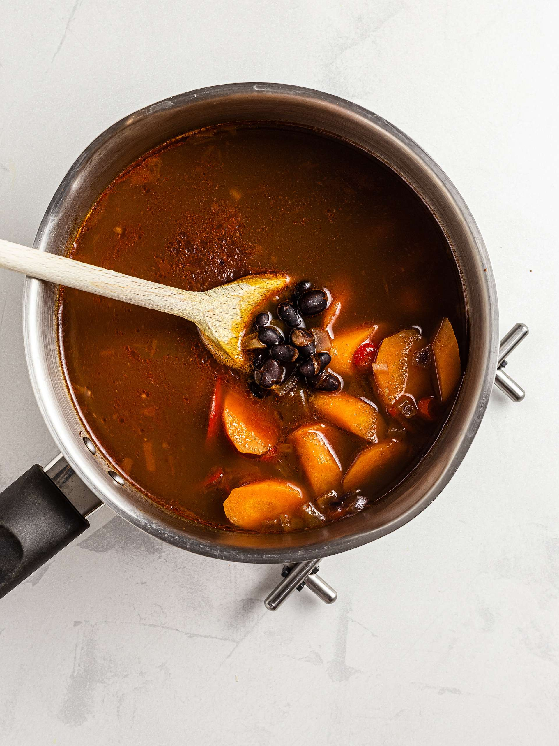 Black beans and carrot stew in a pot