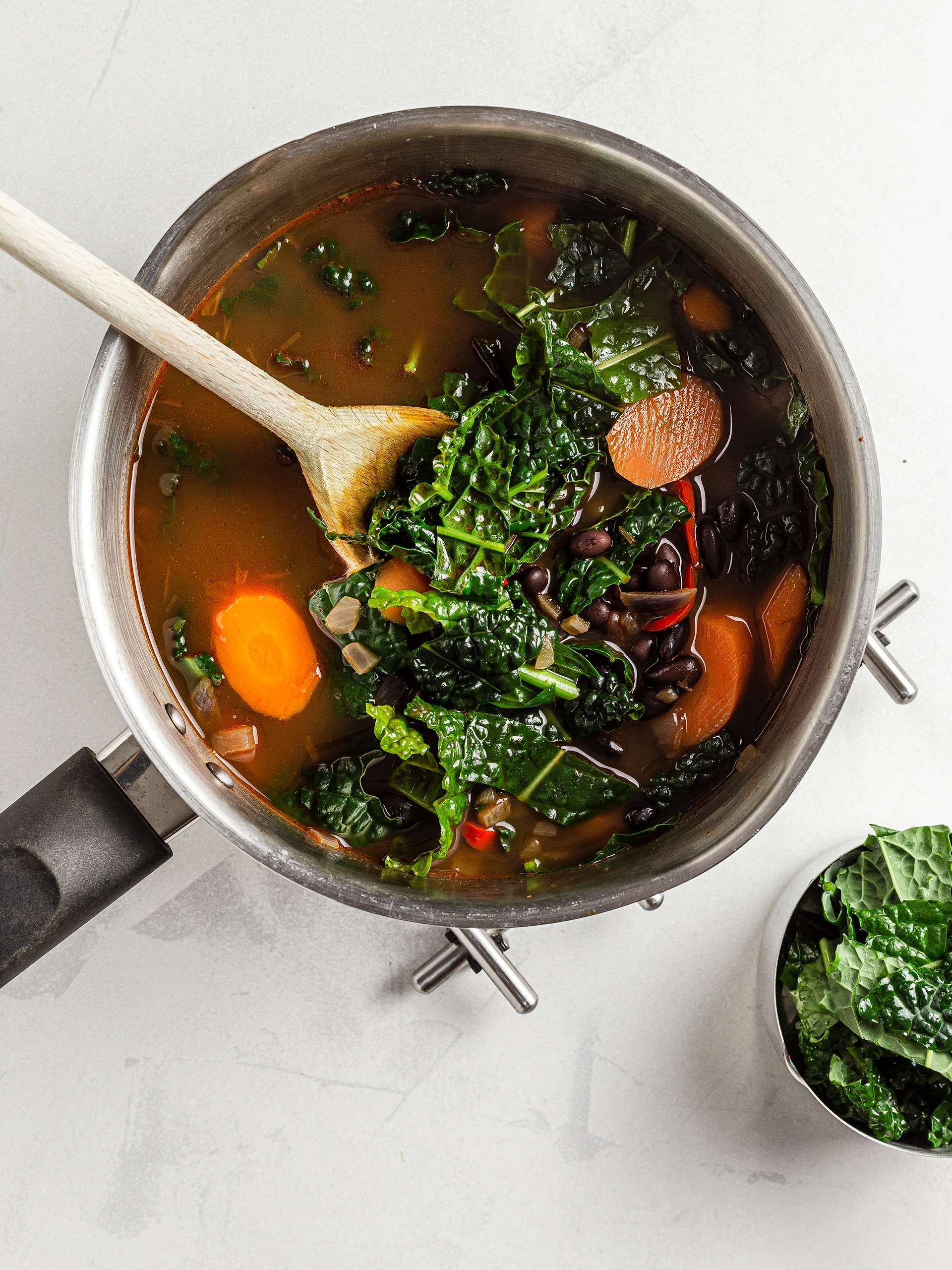 Black kale with carrot and black beans soup
