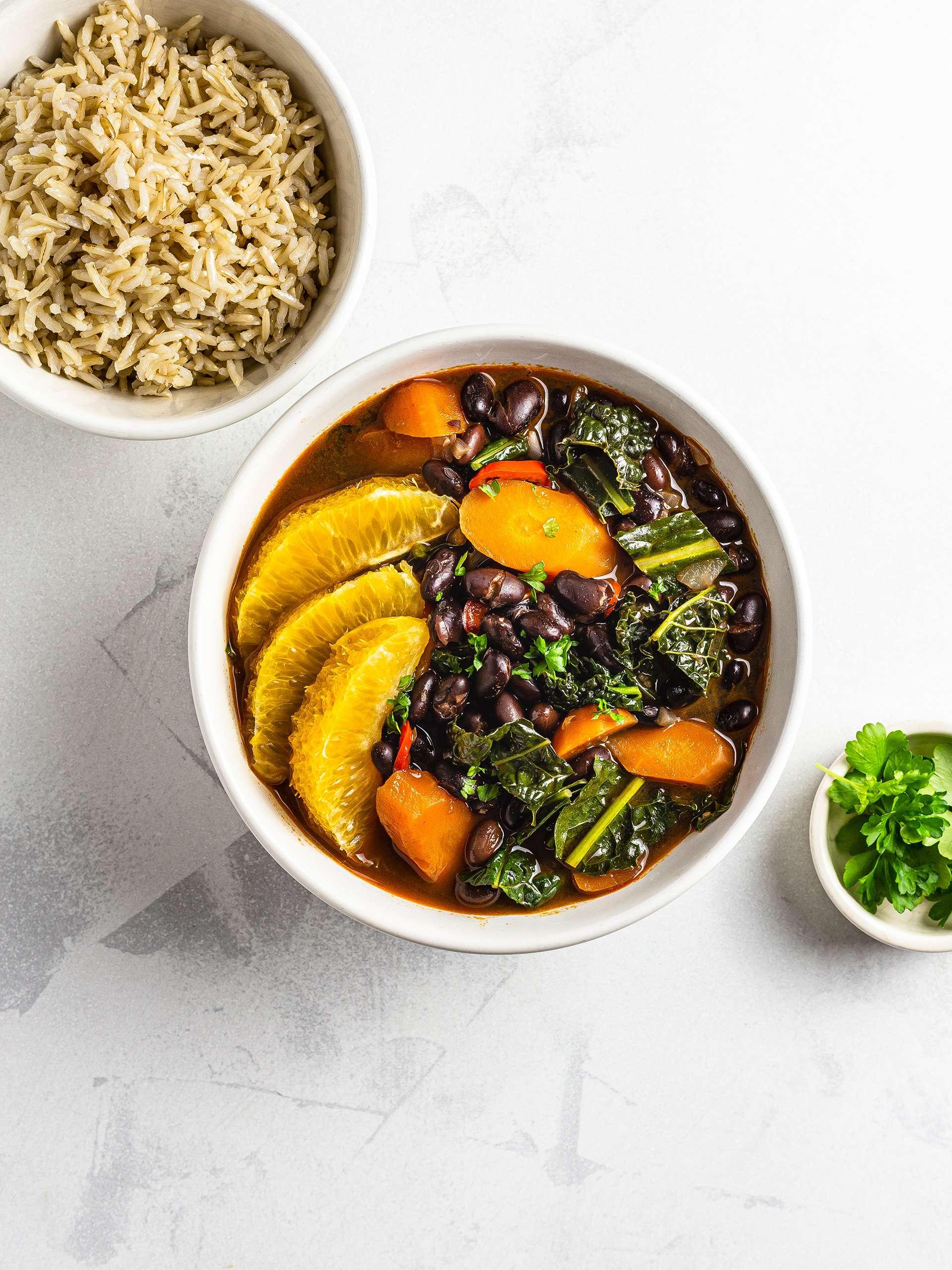 Vegan brazilian feijoada with black beans kale and carrots