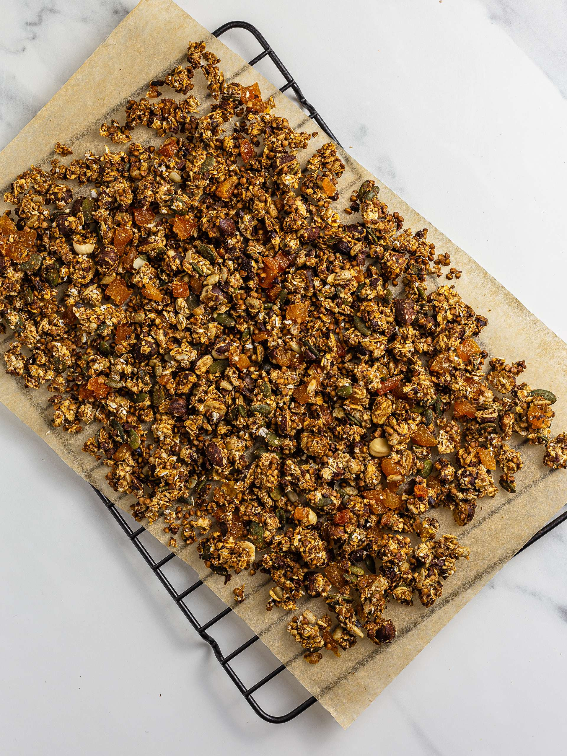 oven-baked granola cooling on a wire rack