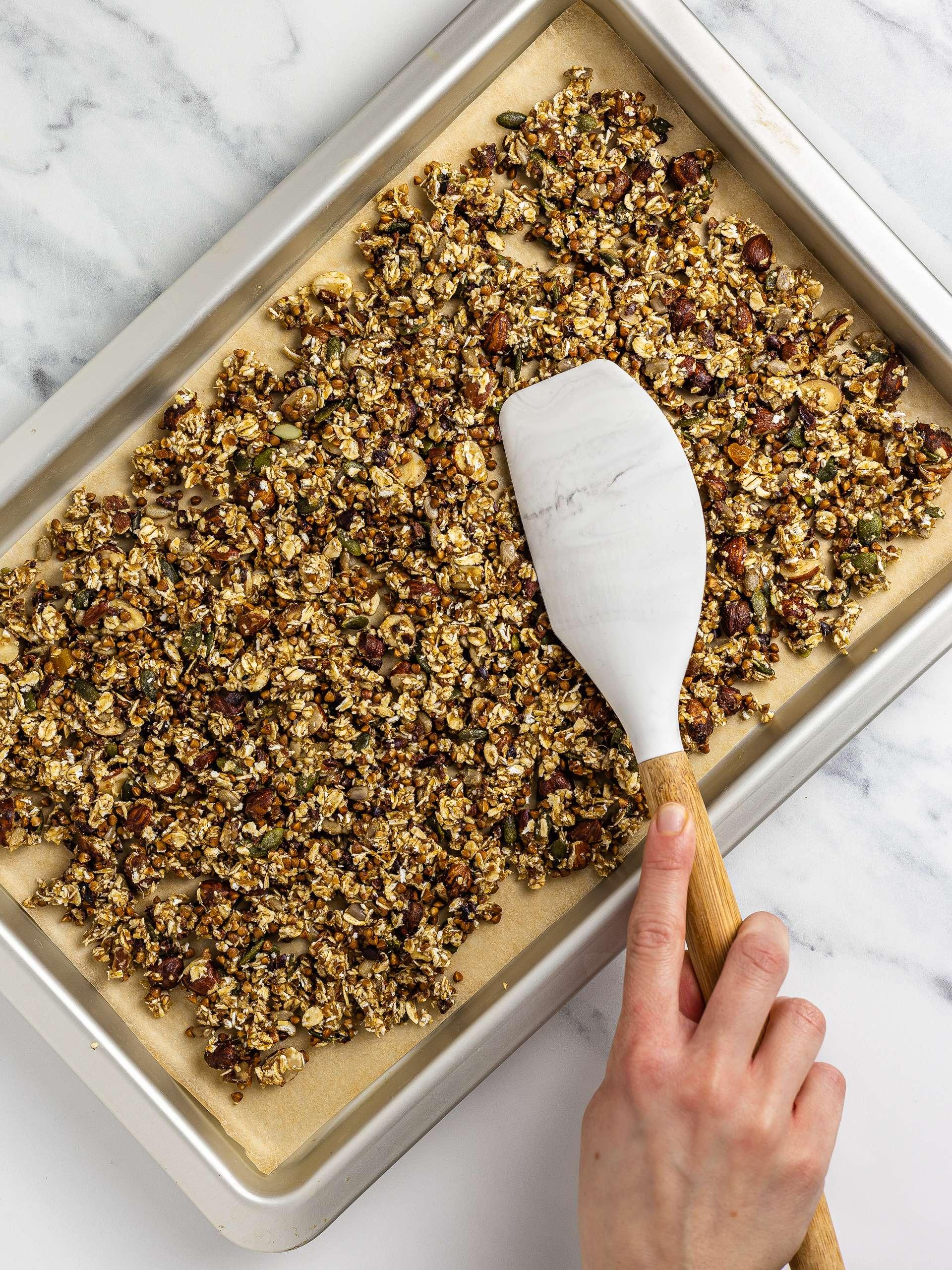 sugar-free granola spread over a baking tray