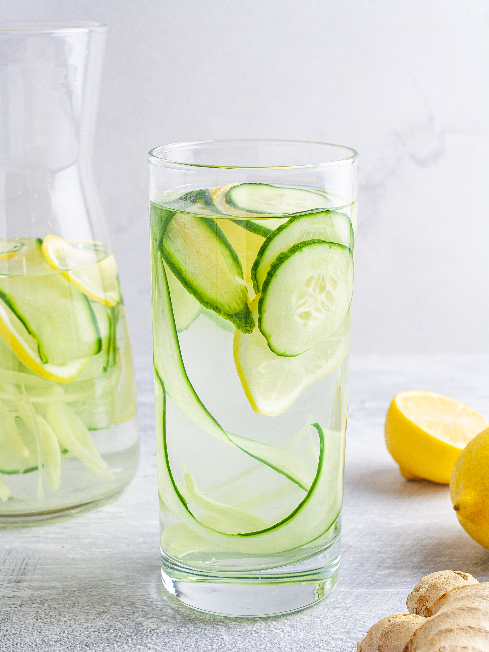 Cucumber ginger lemon water in a glass