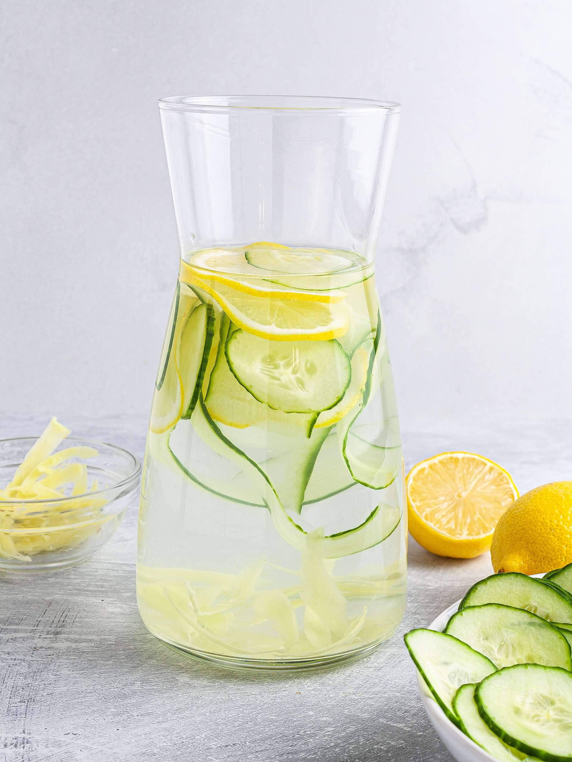 Cucumber ginger lemon water in a jug