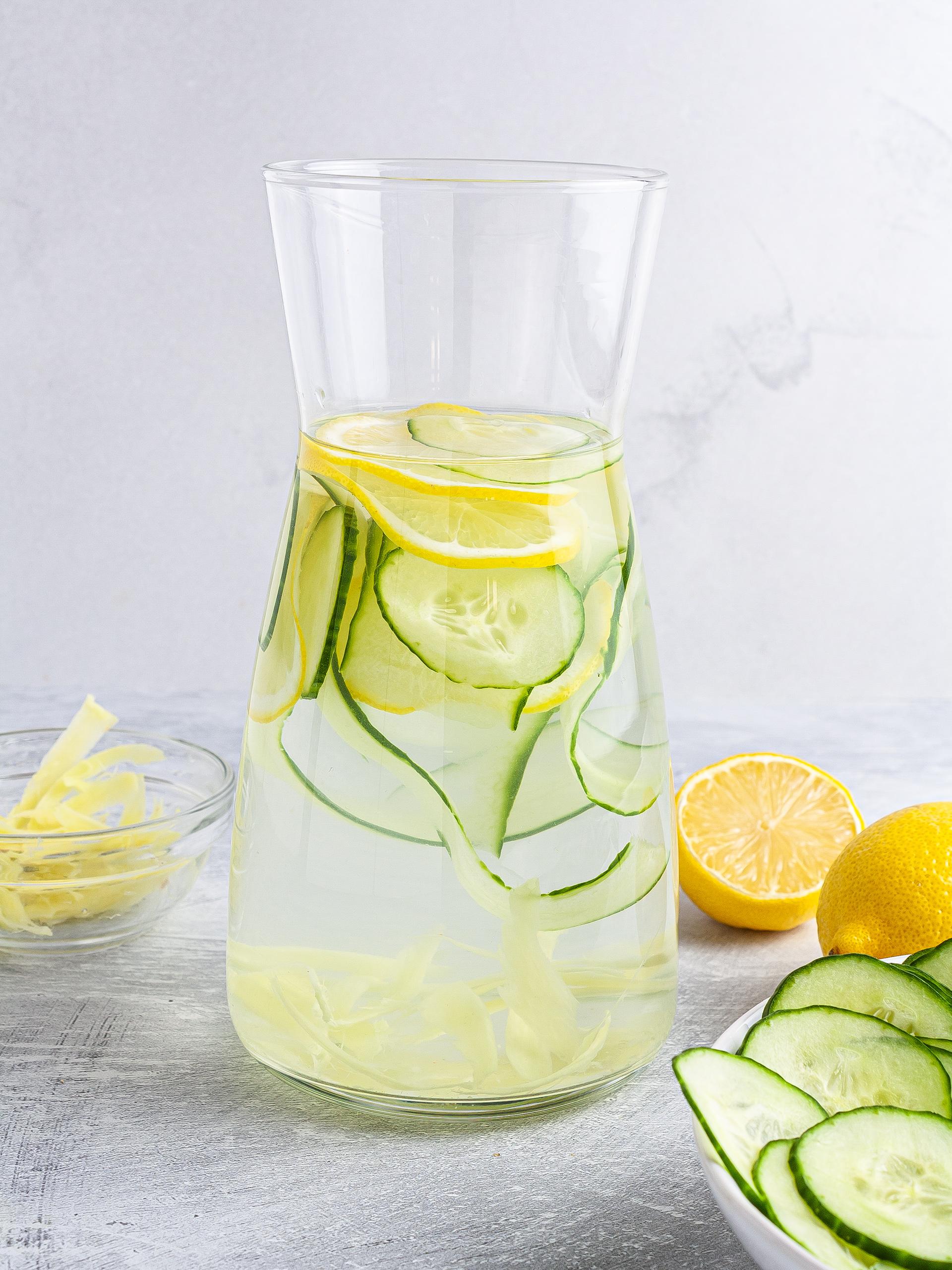 Cucumber ginger lemon water in a jug