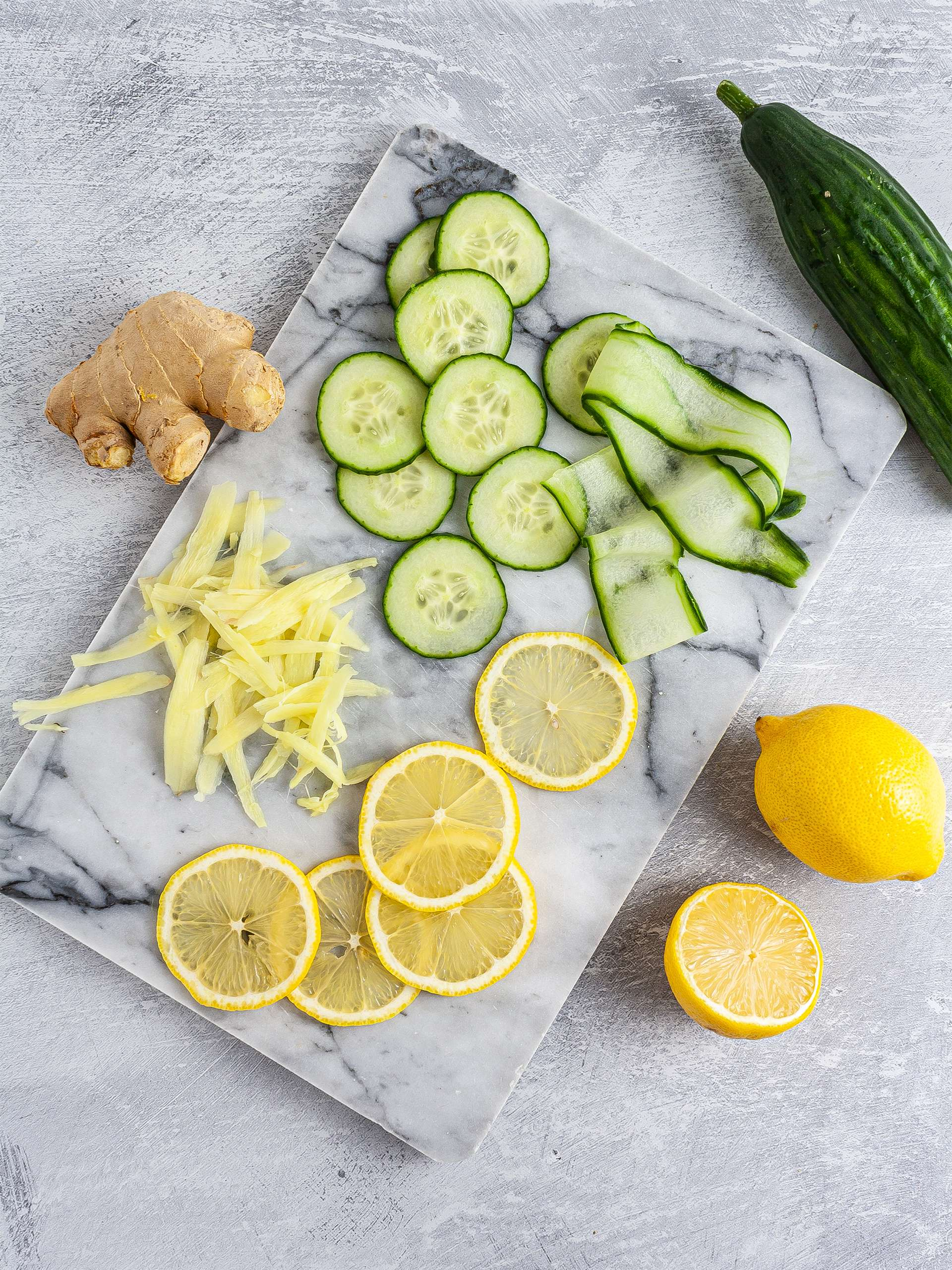 Sliced ginger, lemon, and cucumber