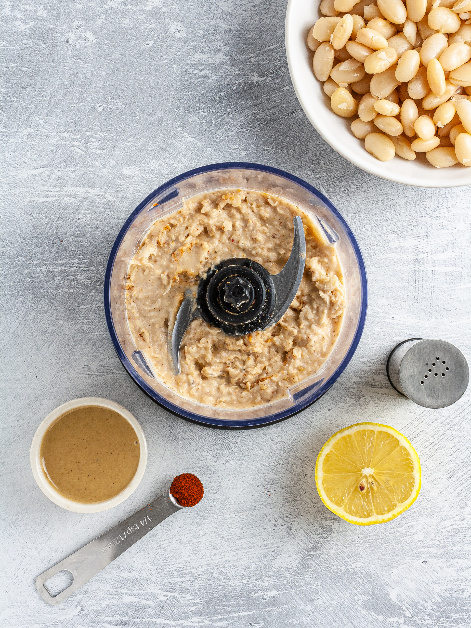 Blended white beans with tahini, lemon, and cayenne pepper.
