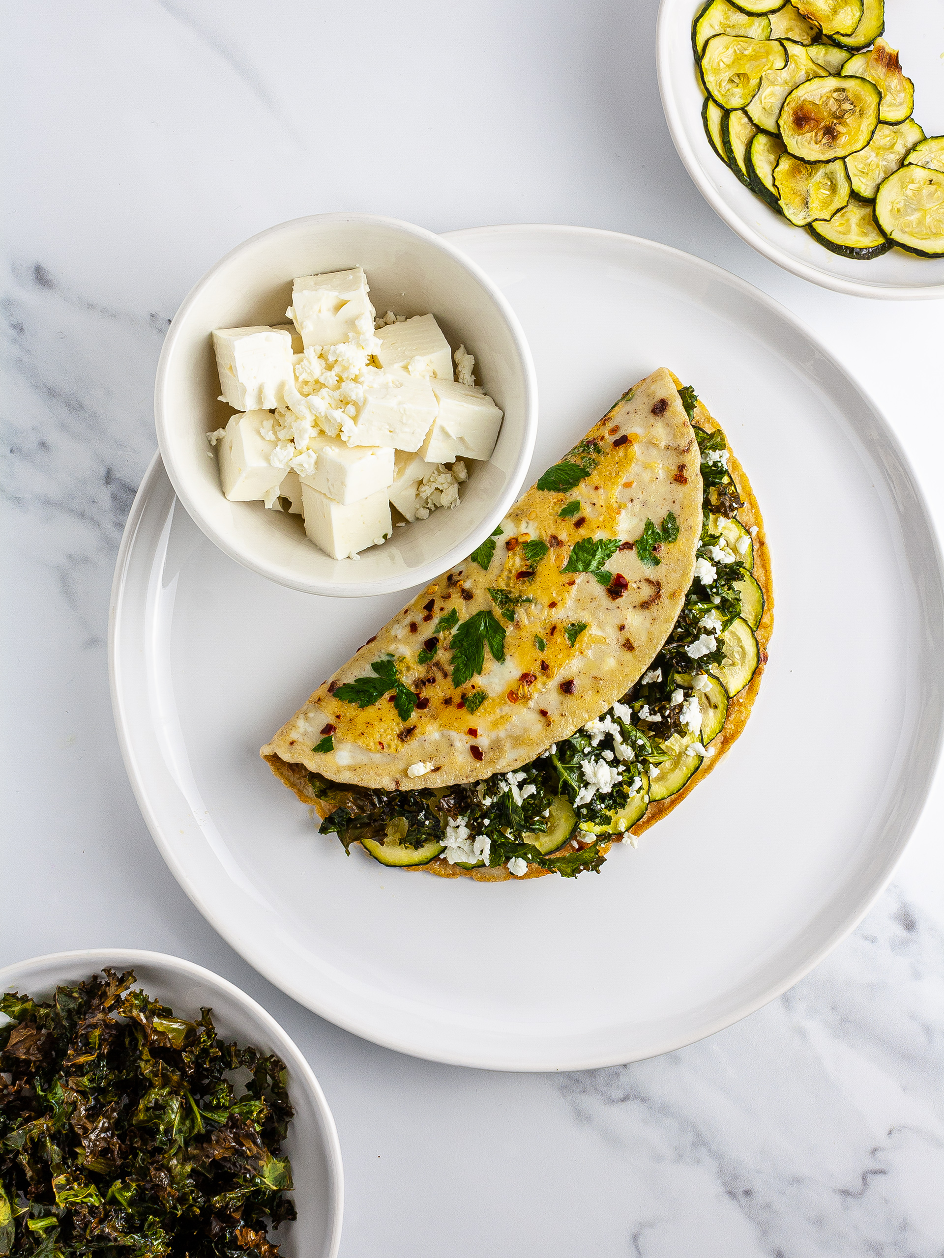 Omelette stuffed with kale, courgettes, and feta.