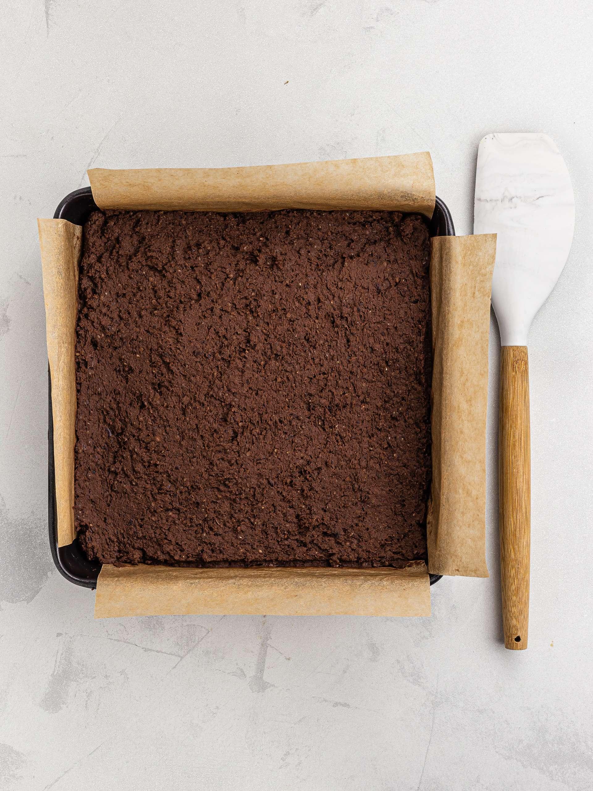 hemp seed brownie dough in a baking tin