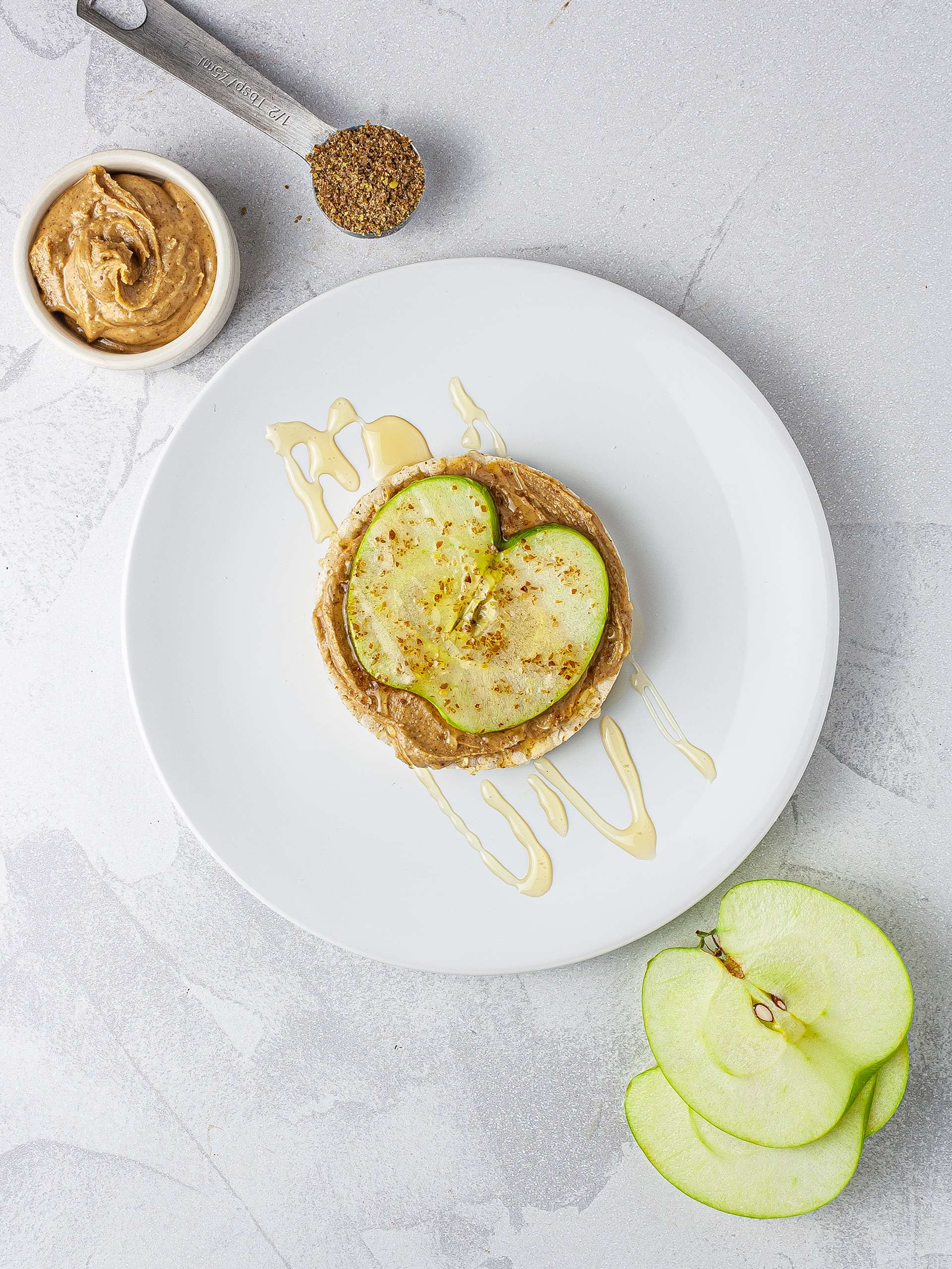 Rice cake with apple, maple syrup, and flaxseeds.