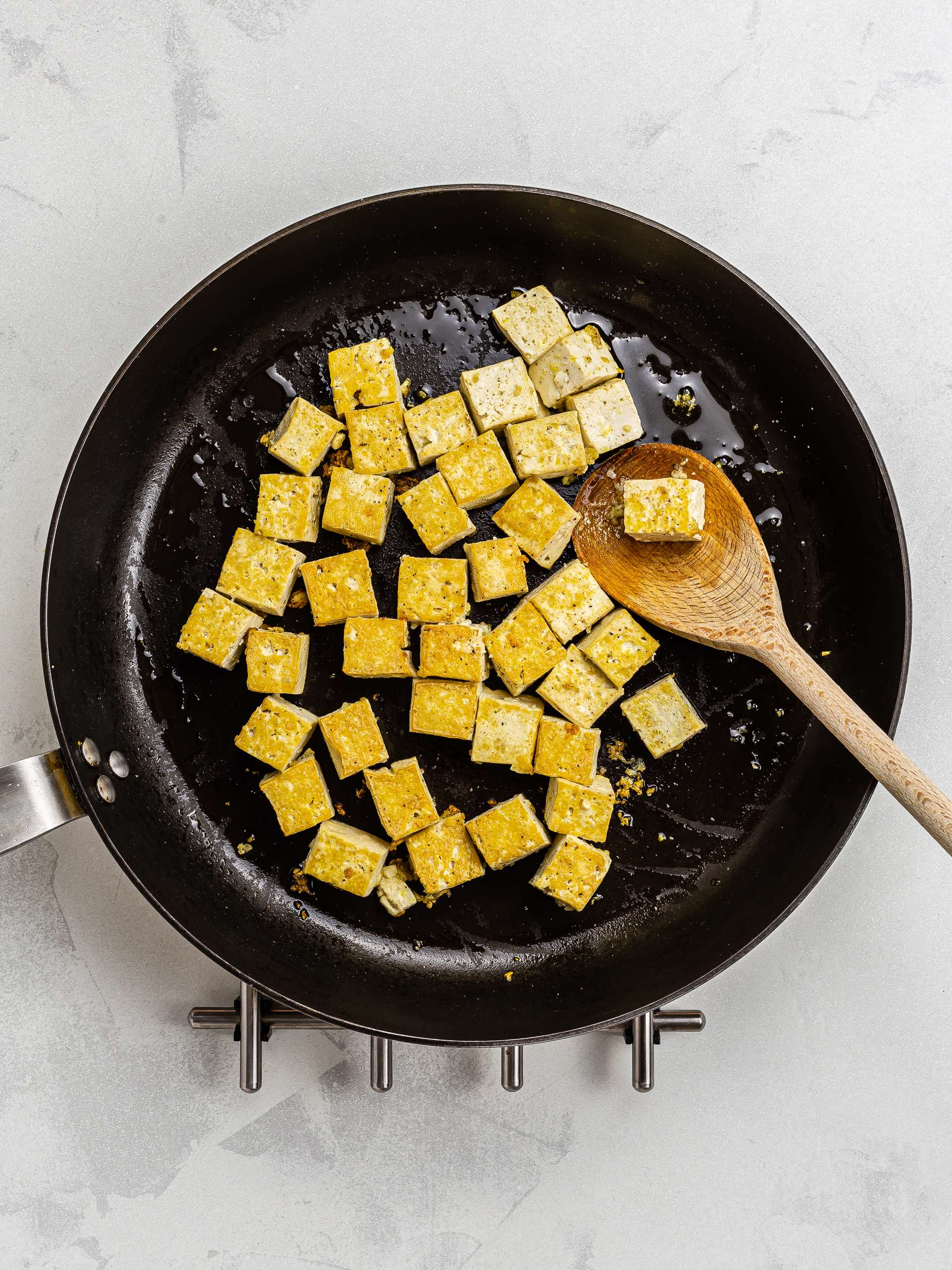 sizzled tofu in a skillet