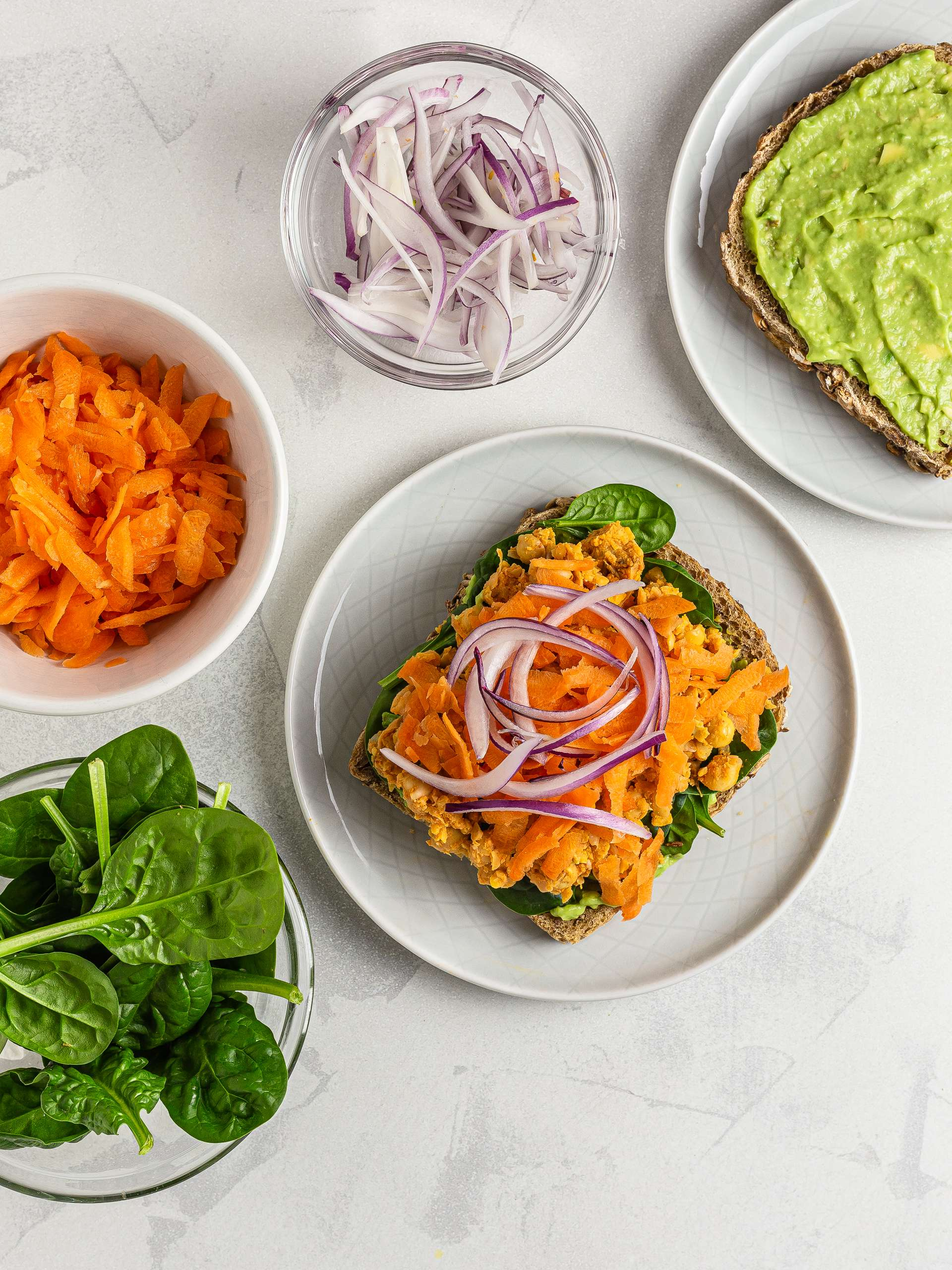 chickpea salad sandwich with carrots spinach and onions