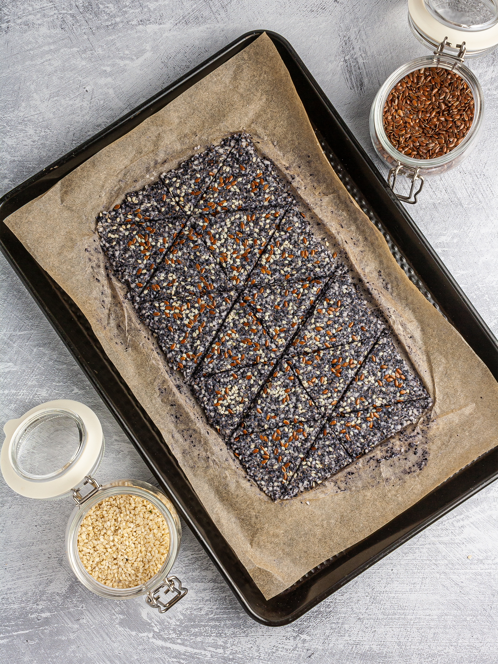 Black bean dough spread on baking paper