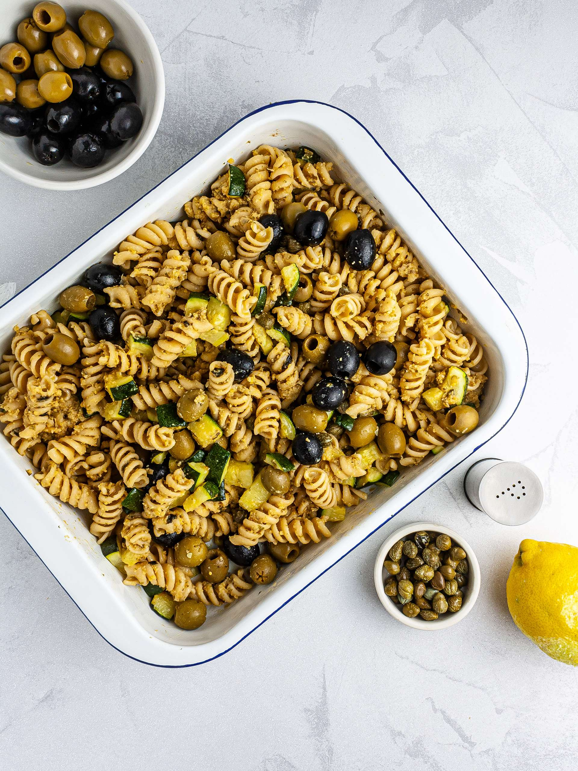 Pasta salad with olives, capers and lemon zest