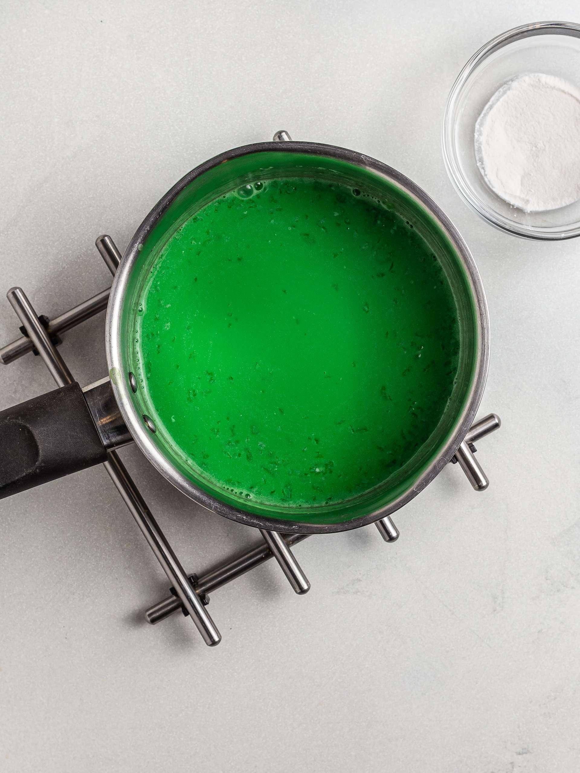 pandan milk jelly cooking in a pot