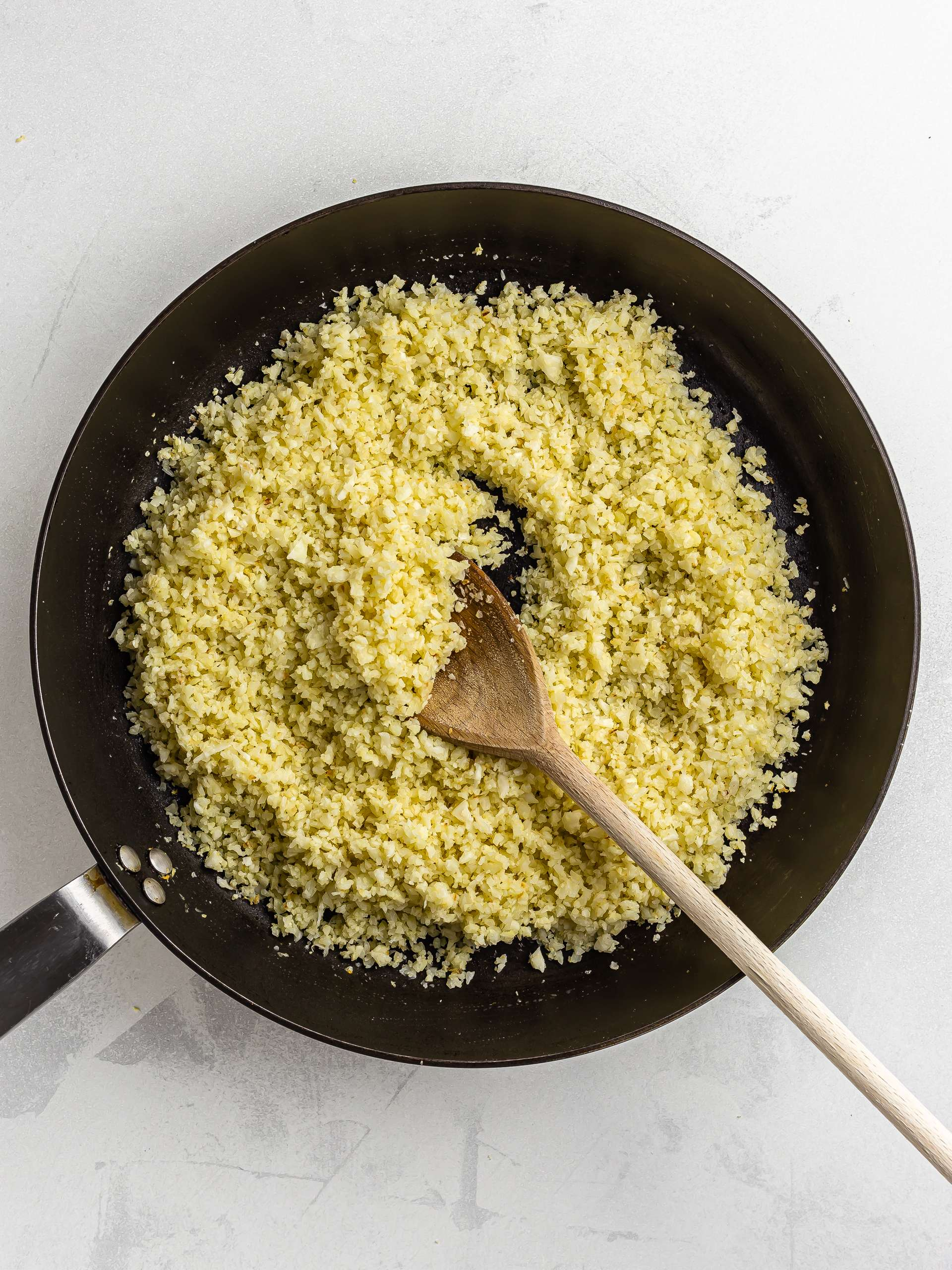 cooked cauliflower rice in a skillet