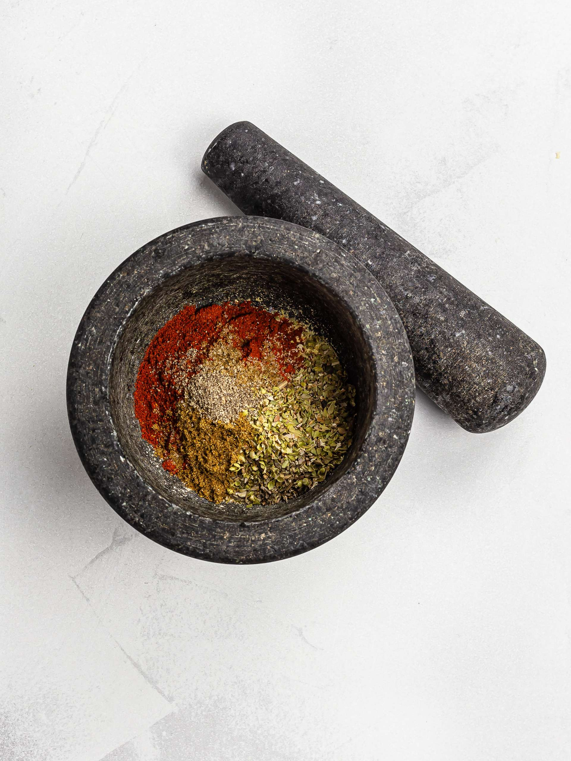 red robin seasoning ingredients in a mortar