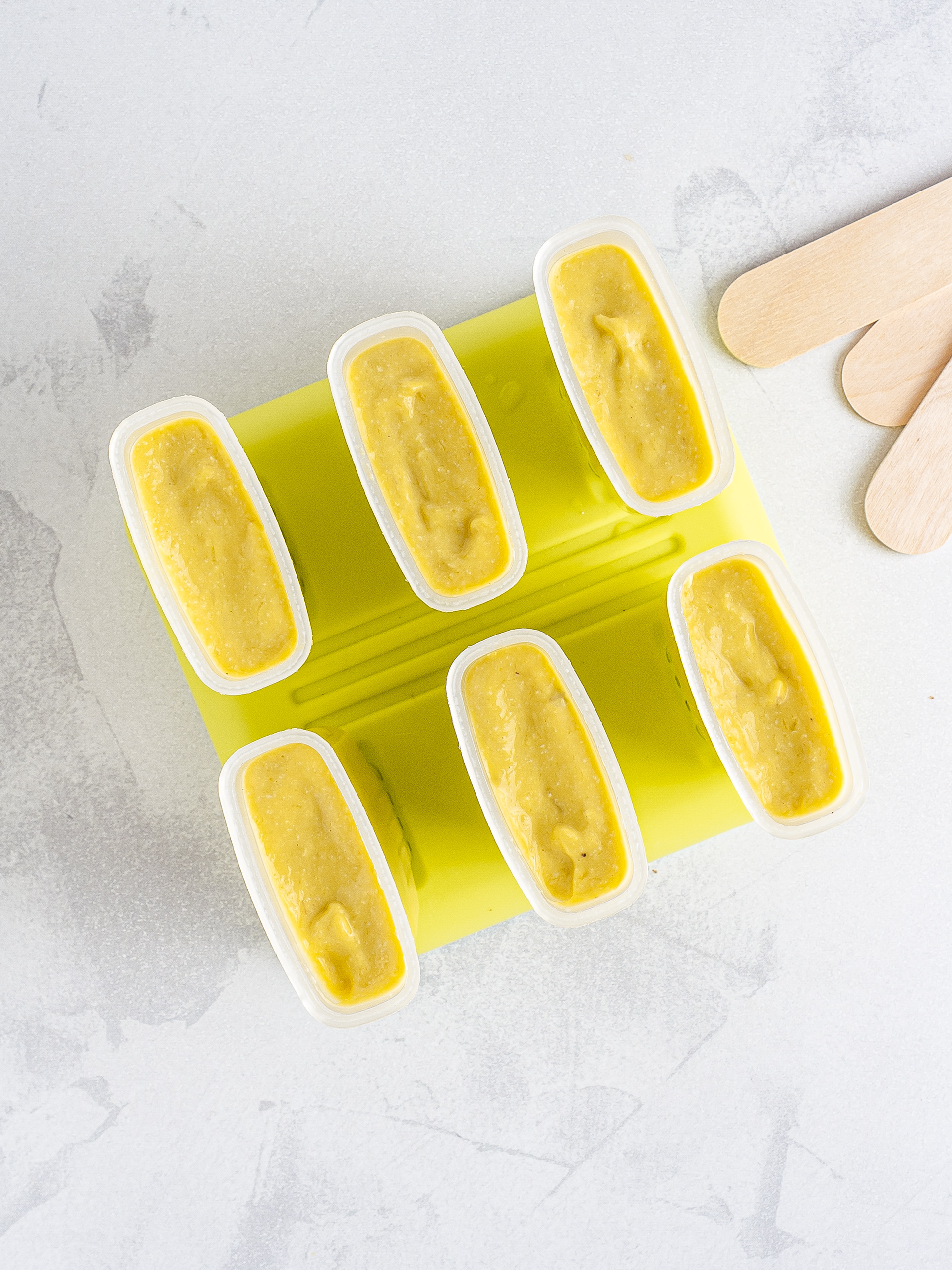 Mango malai kulfi in ice lolly moulds