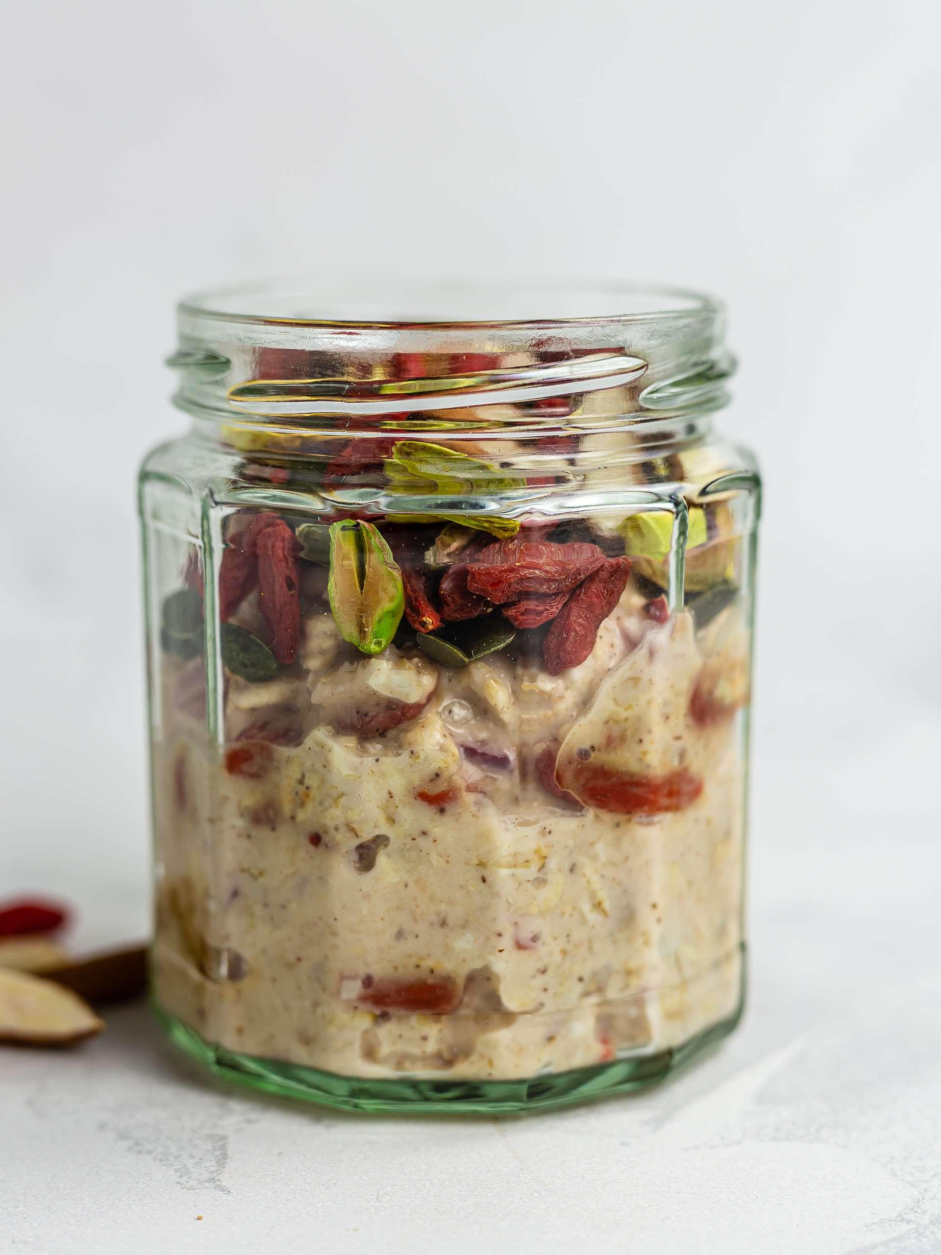 pistachios, almond, and pumpkin seeds with bircher muesli in a jar