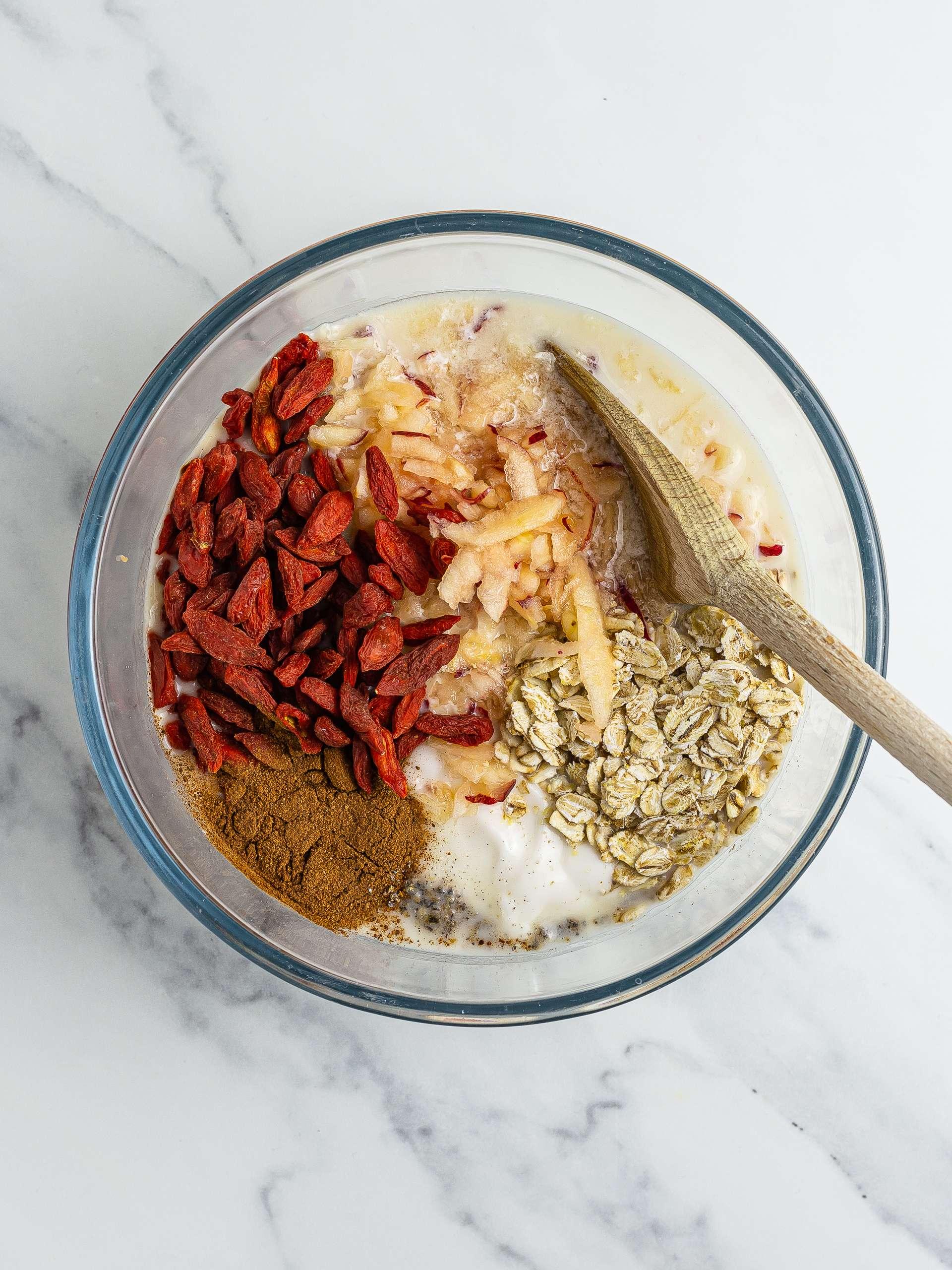 Goji, apple, and cinnamon muesli ingredients in a bowl