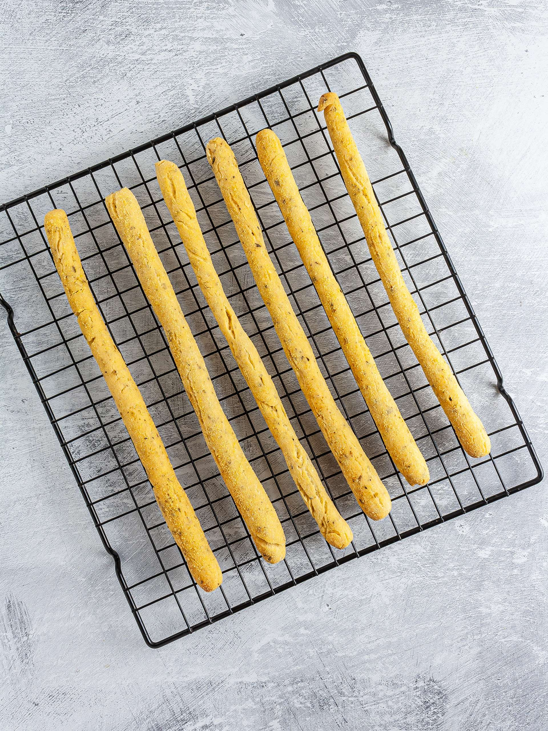 Baked breadsticks on a wire rack