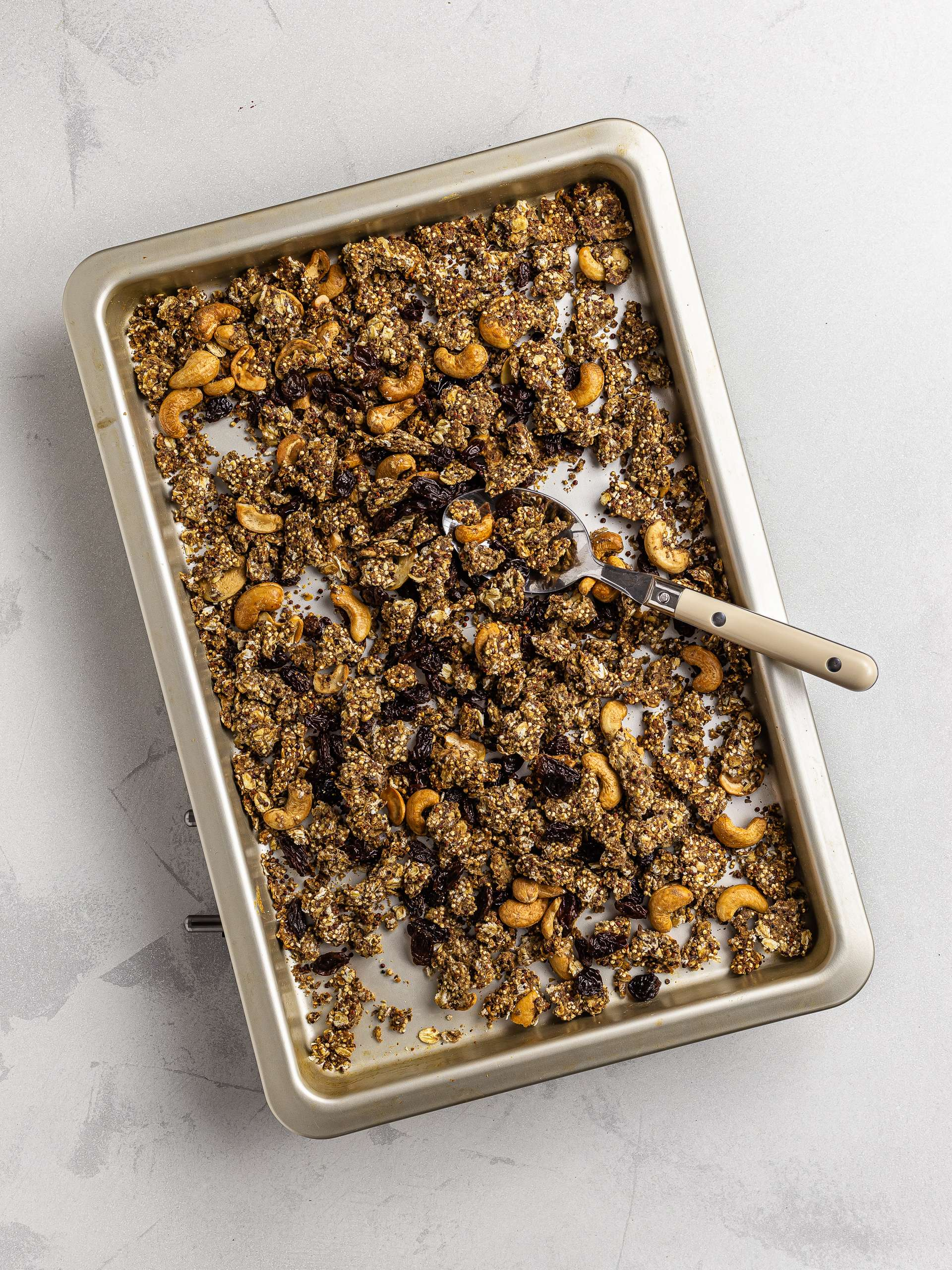 cashew granola with raisins on a baking tray
