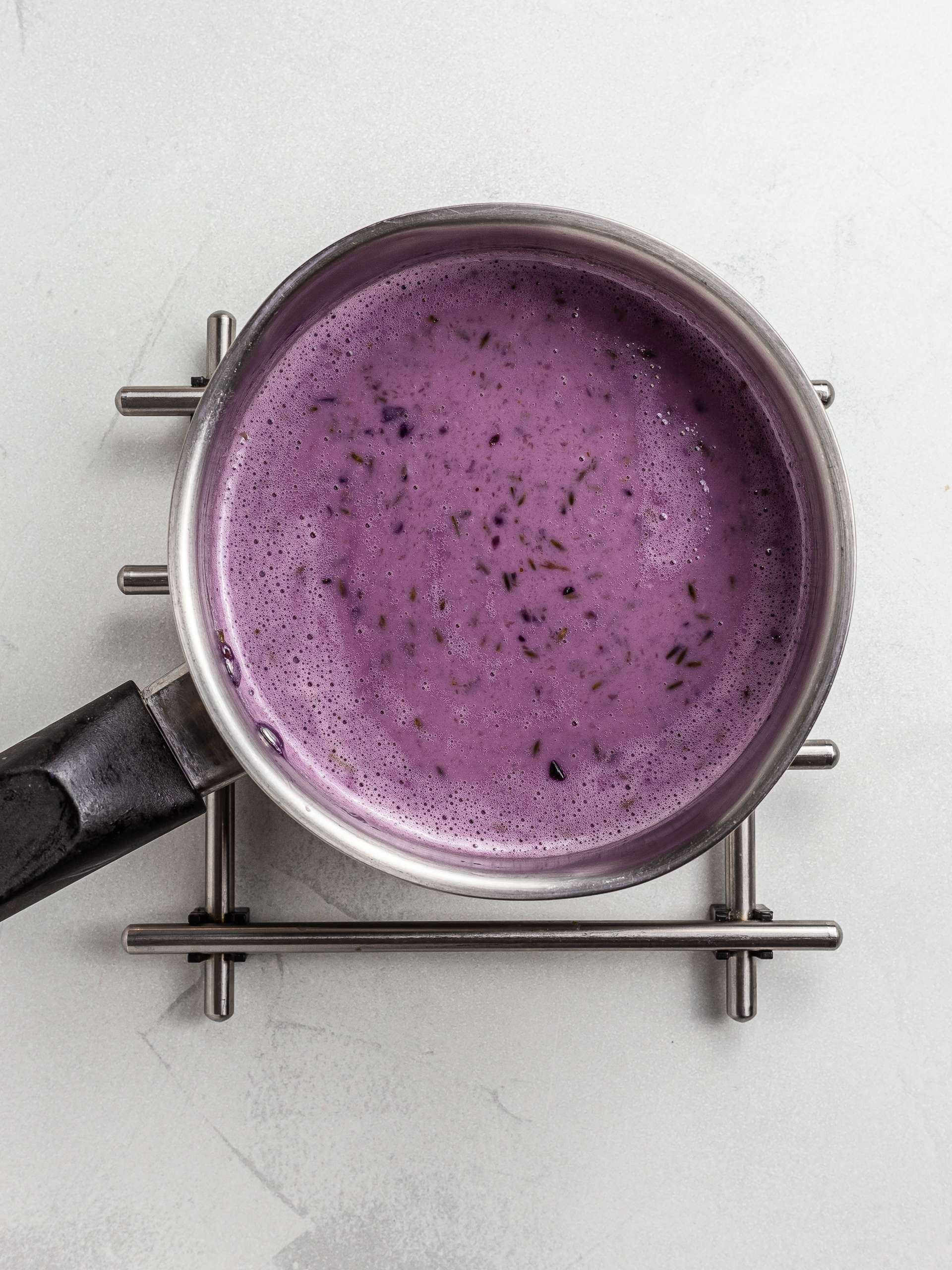 lavender ice cream base in a pot