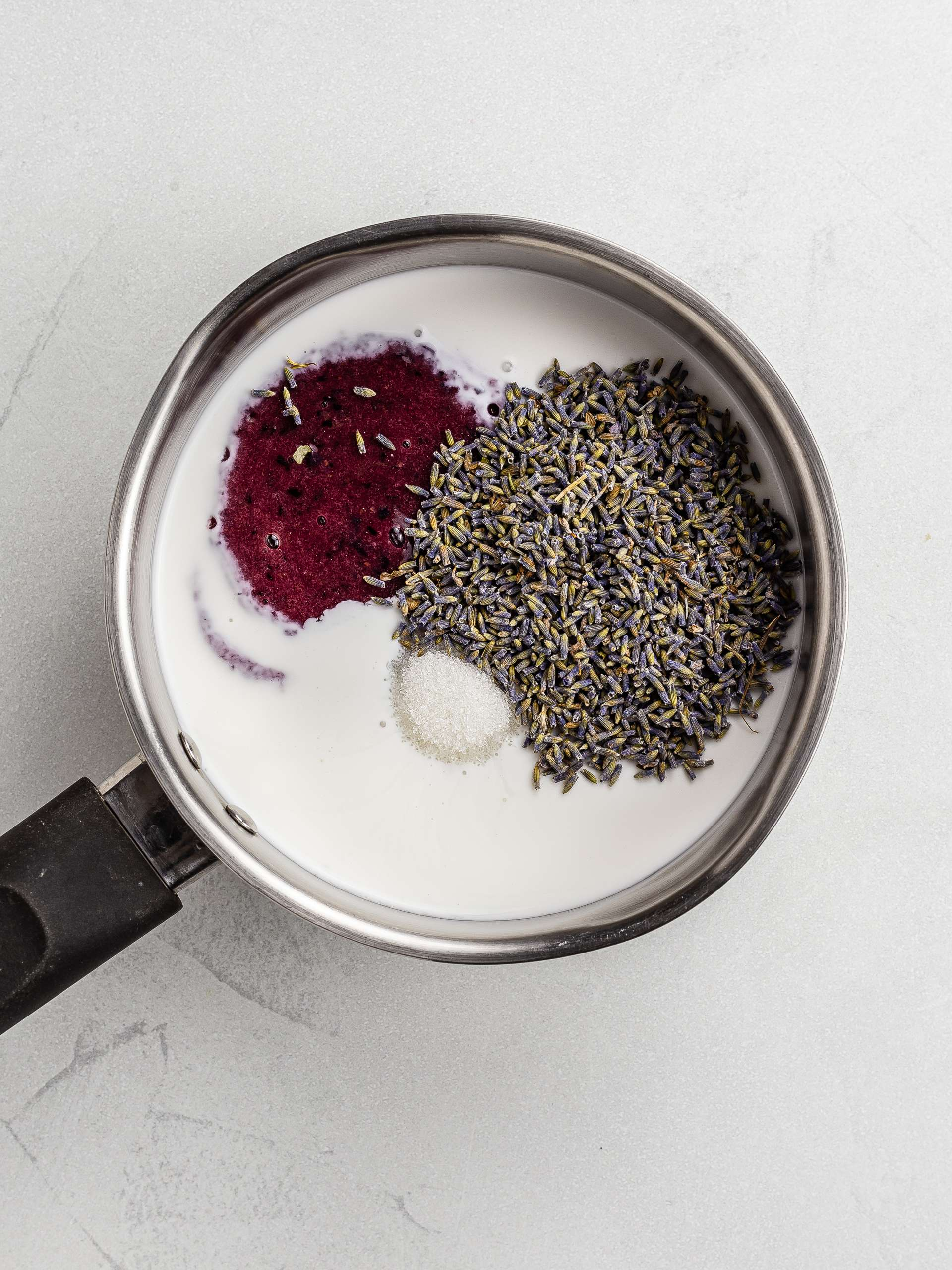 lavender, blueberry puree, and coconut milk in a pot