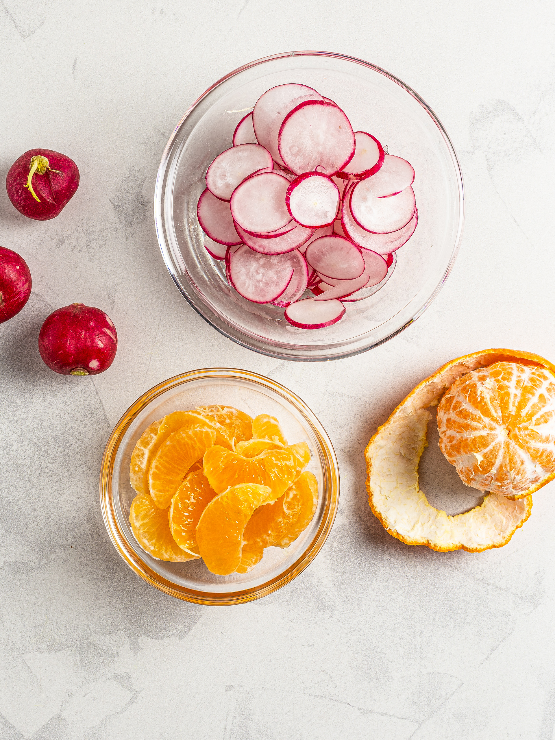 Sliced radishes and tangerines