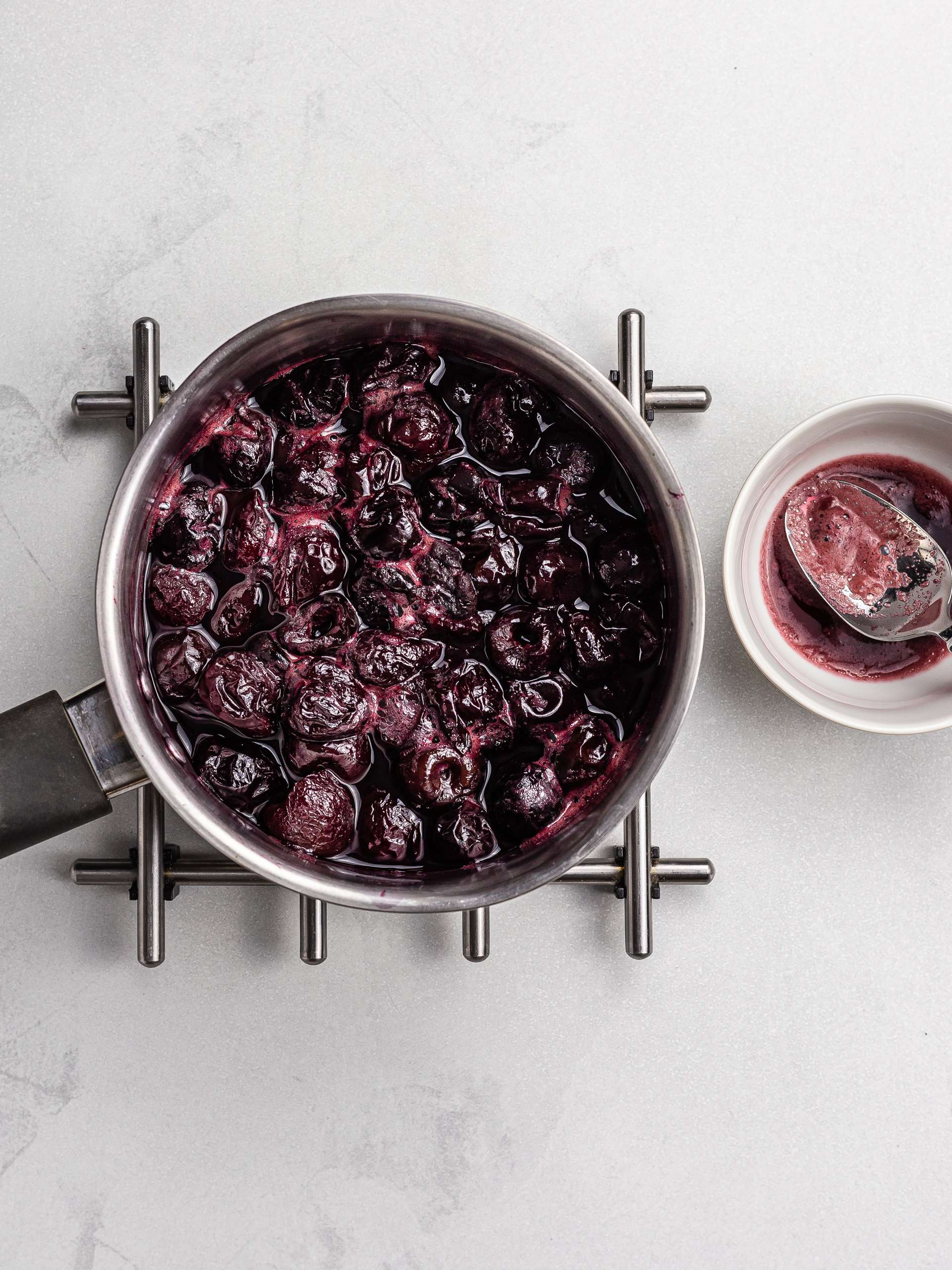 cherries cooking with water in a pot