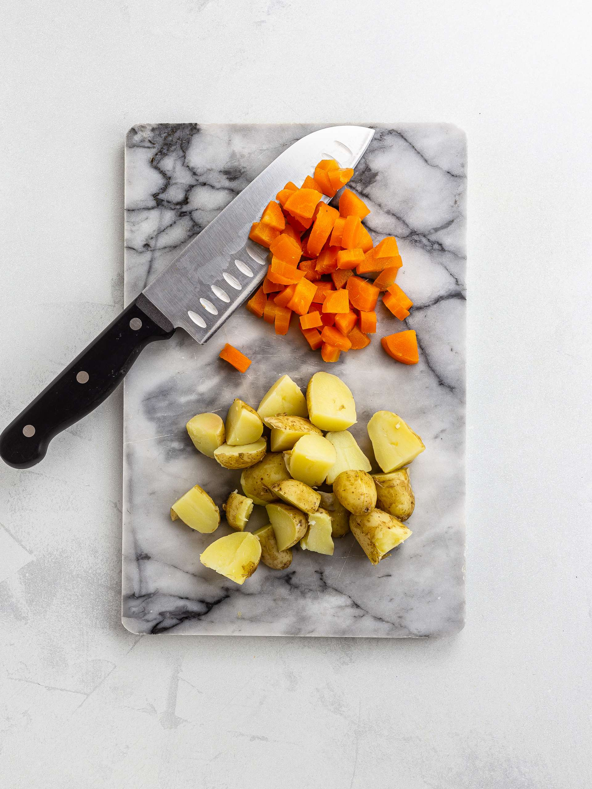 chopped potatoes and carrots