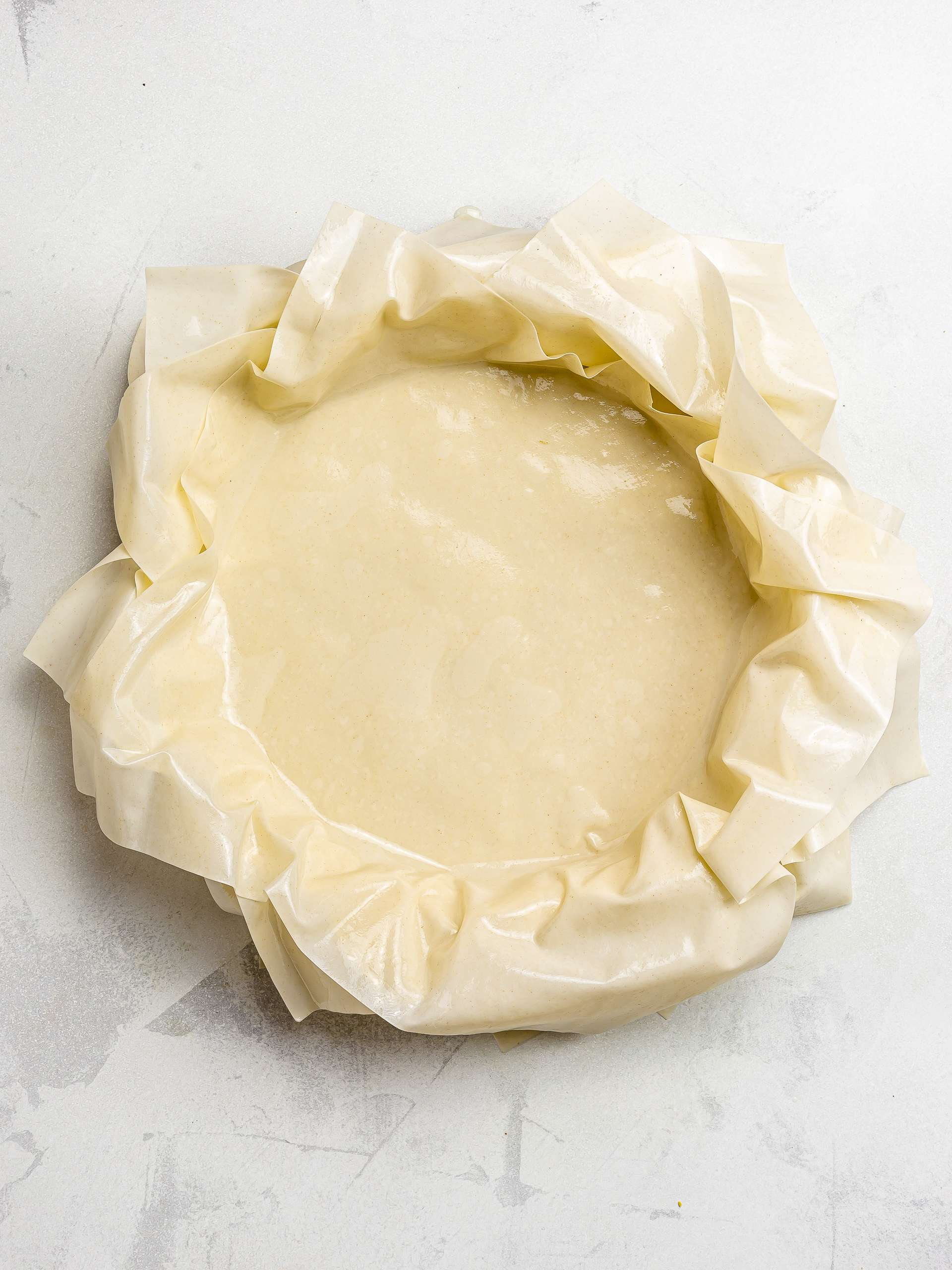 pie dish lined with filo sheets