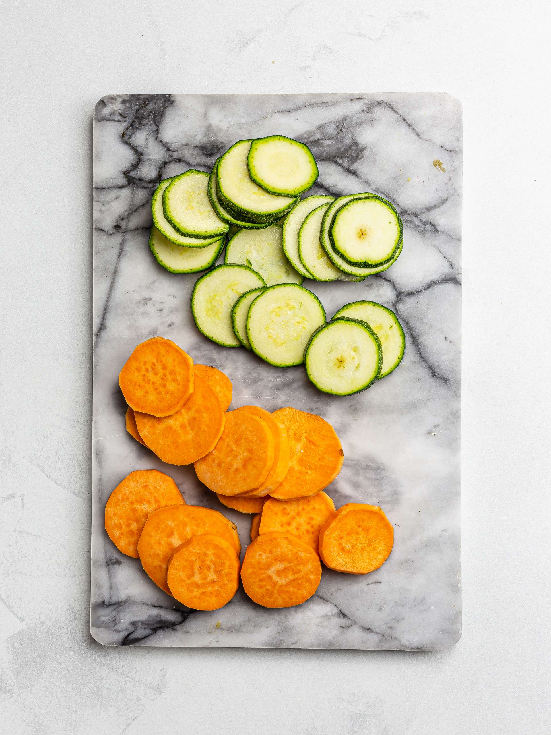 sliced courgettes and sweet potatoes