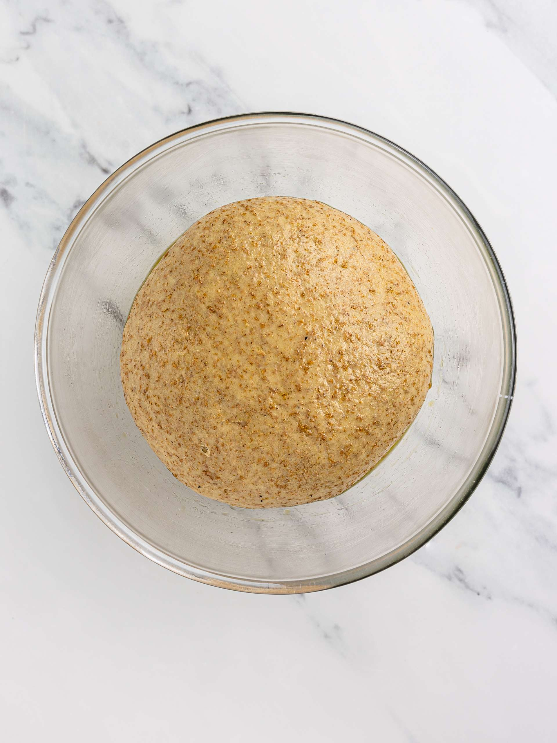proved yeast cake dough in a bowl