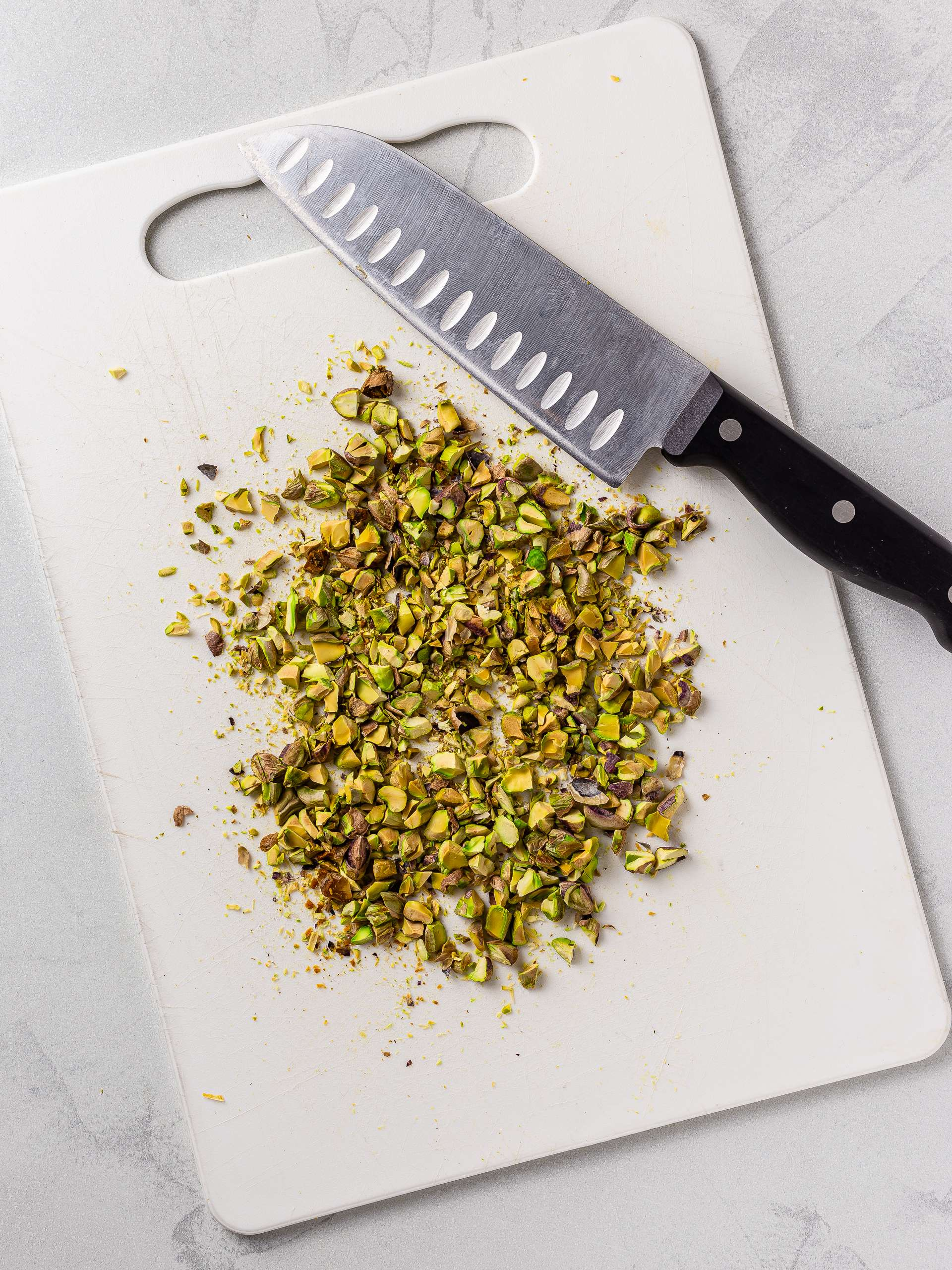 chopped pistachios on a chopping board