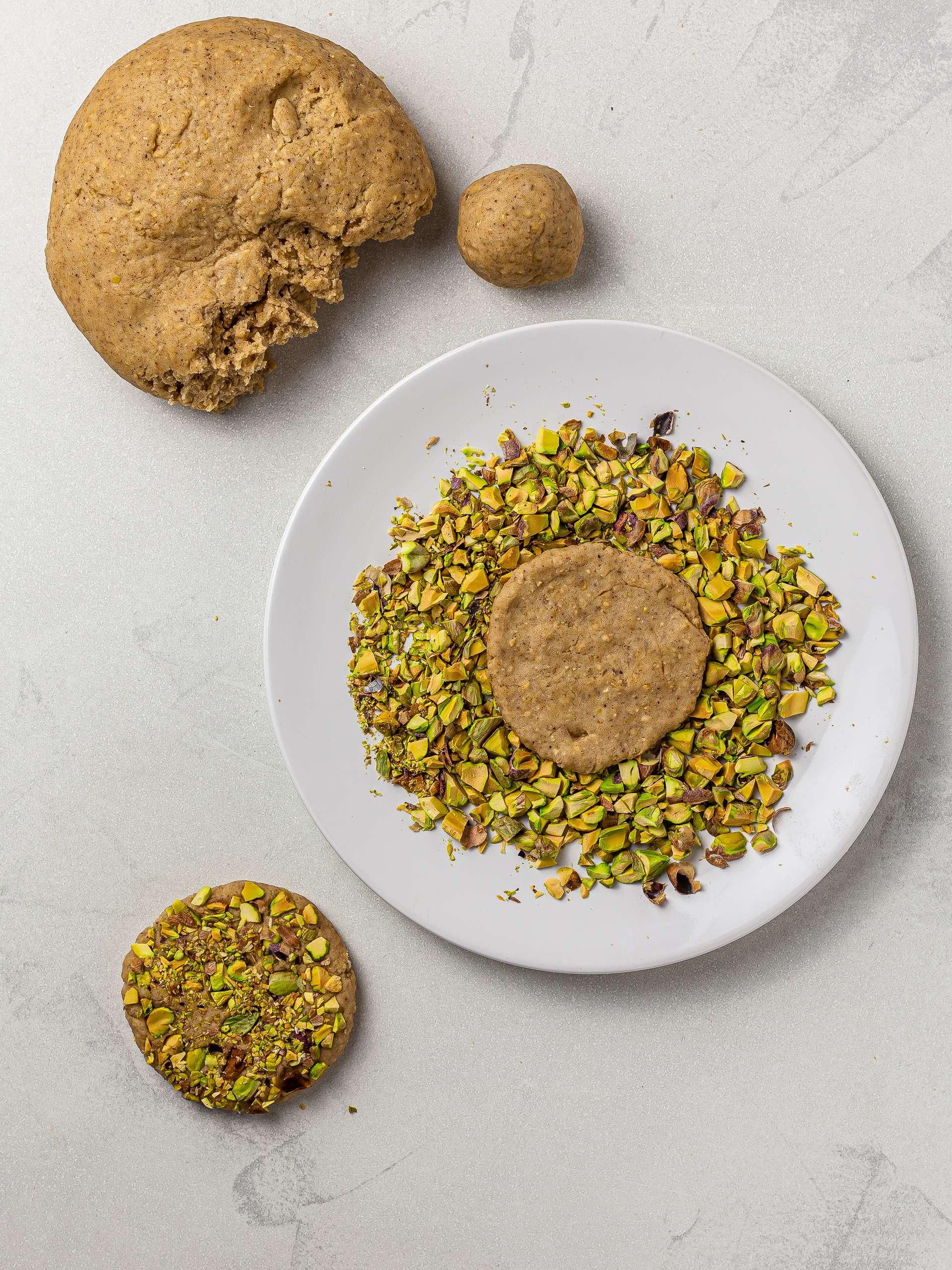 tahini cookies coated with chopped pistachios