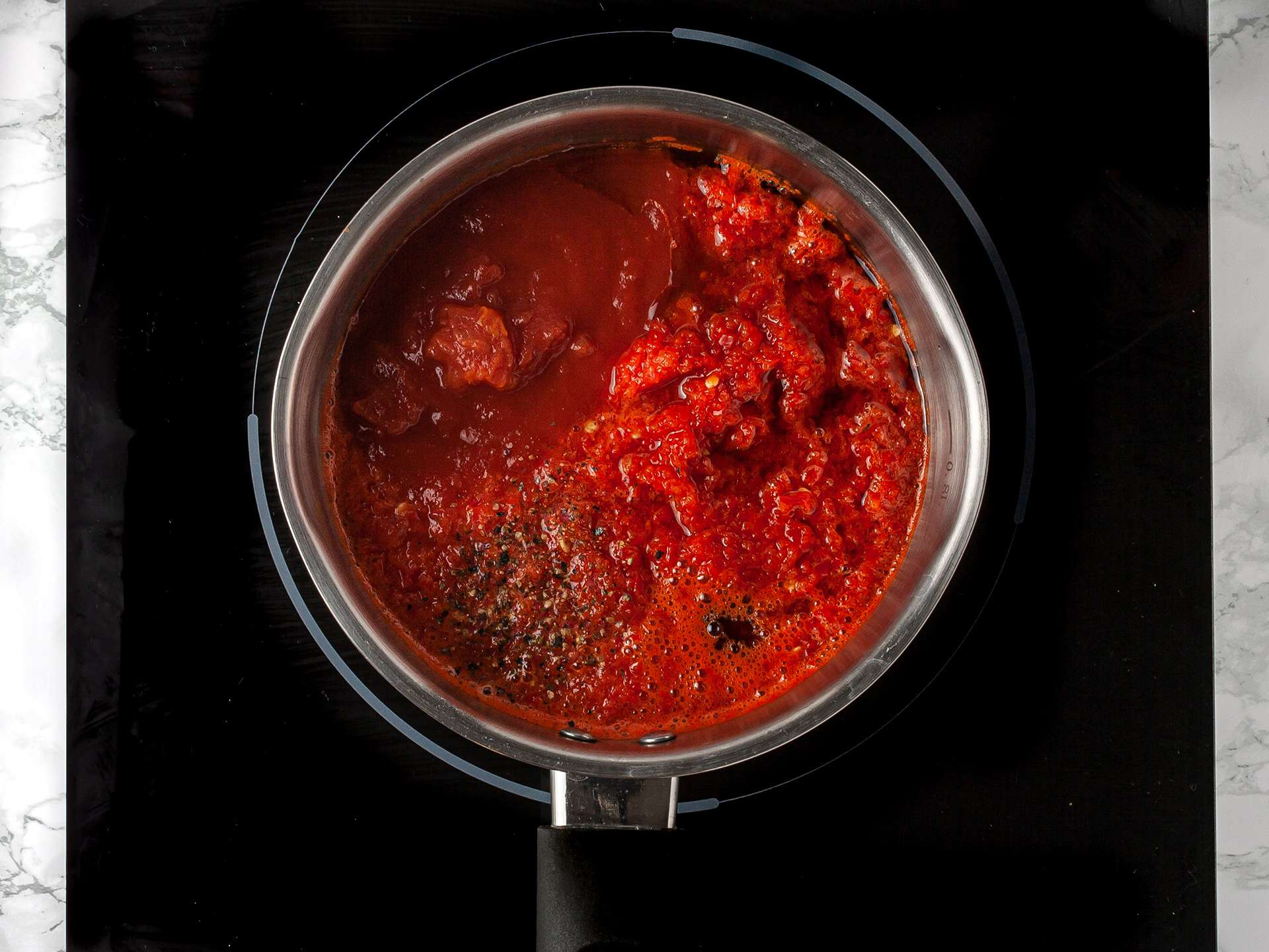Asian chilli jam cooking in a pot