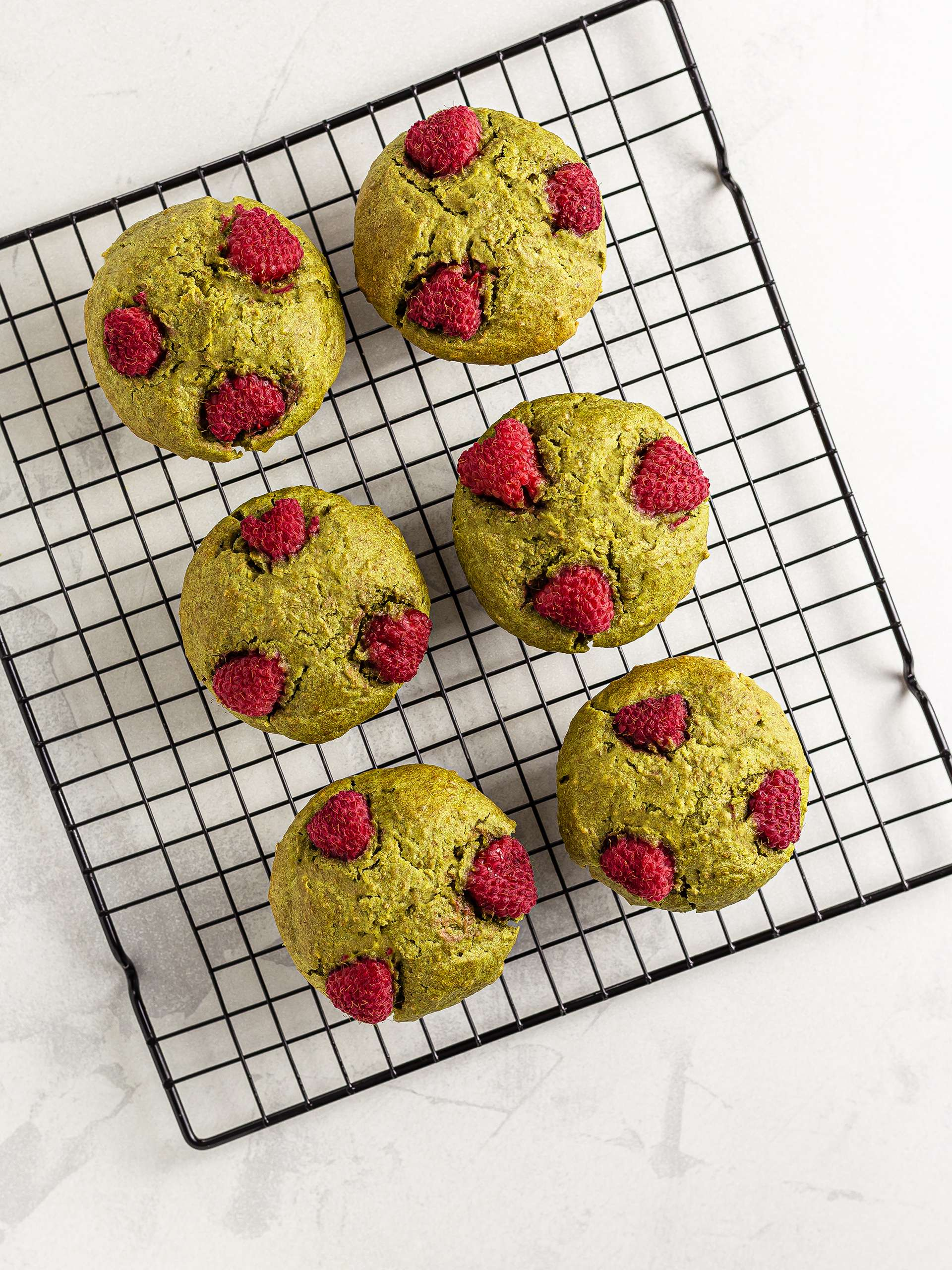 baked vegan matcha muffins on a wire rack