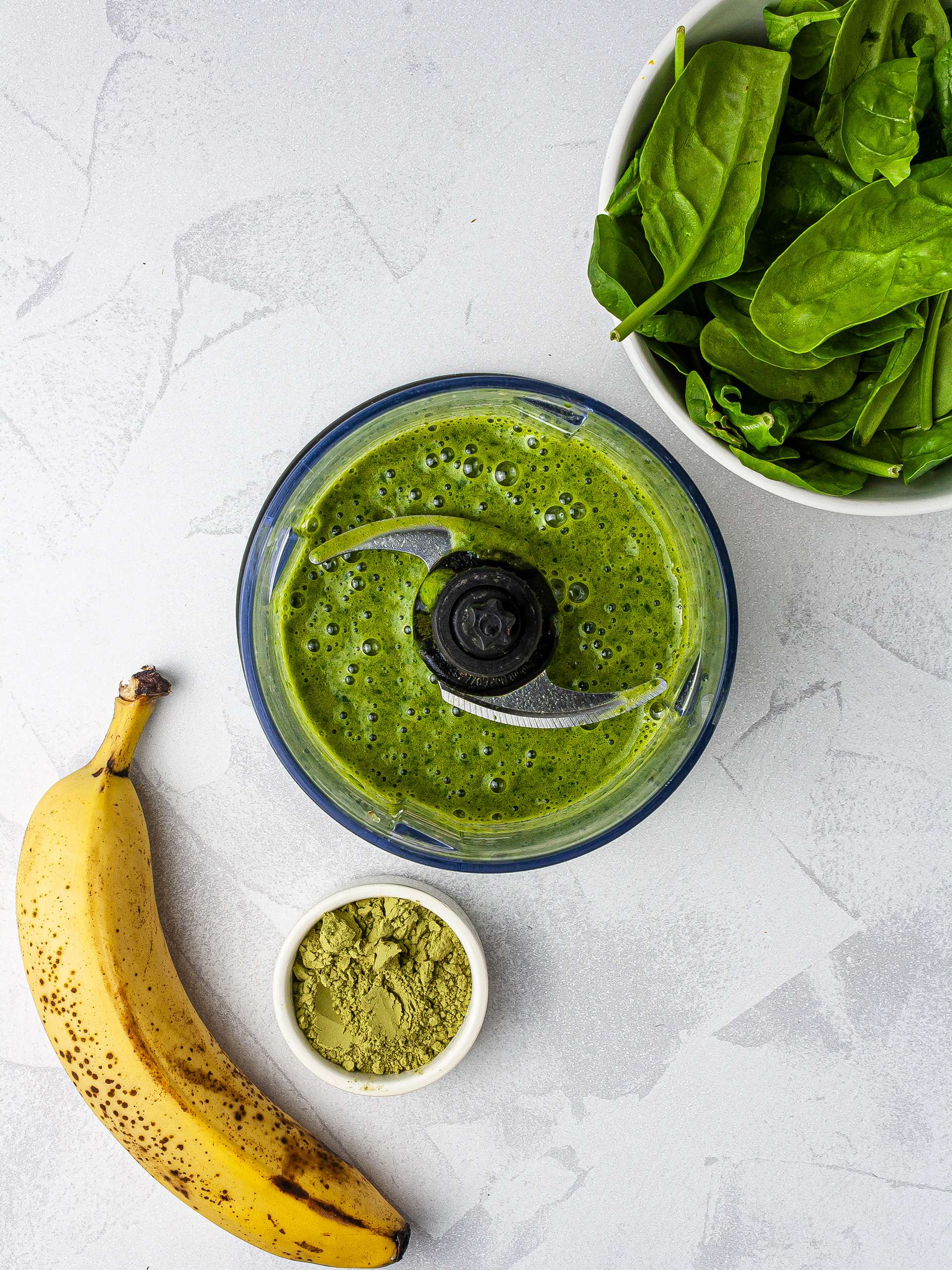 Green smoothie with spinach, banana, and match green tea powder.