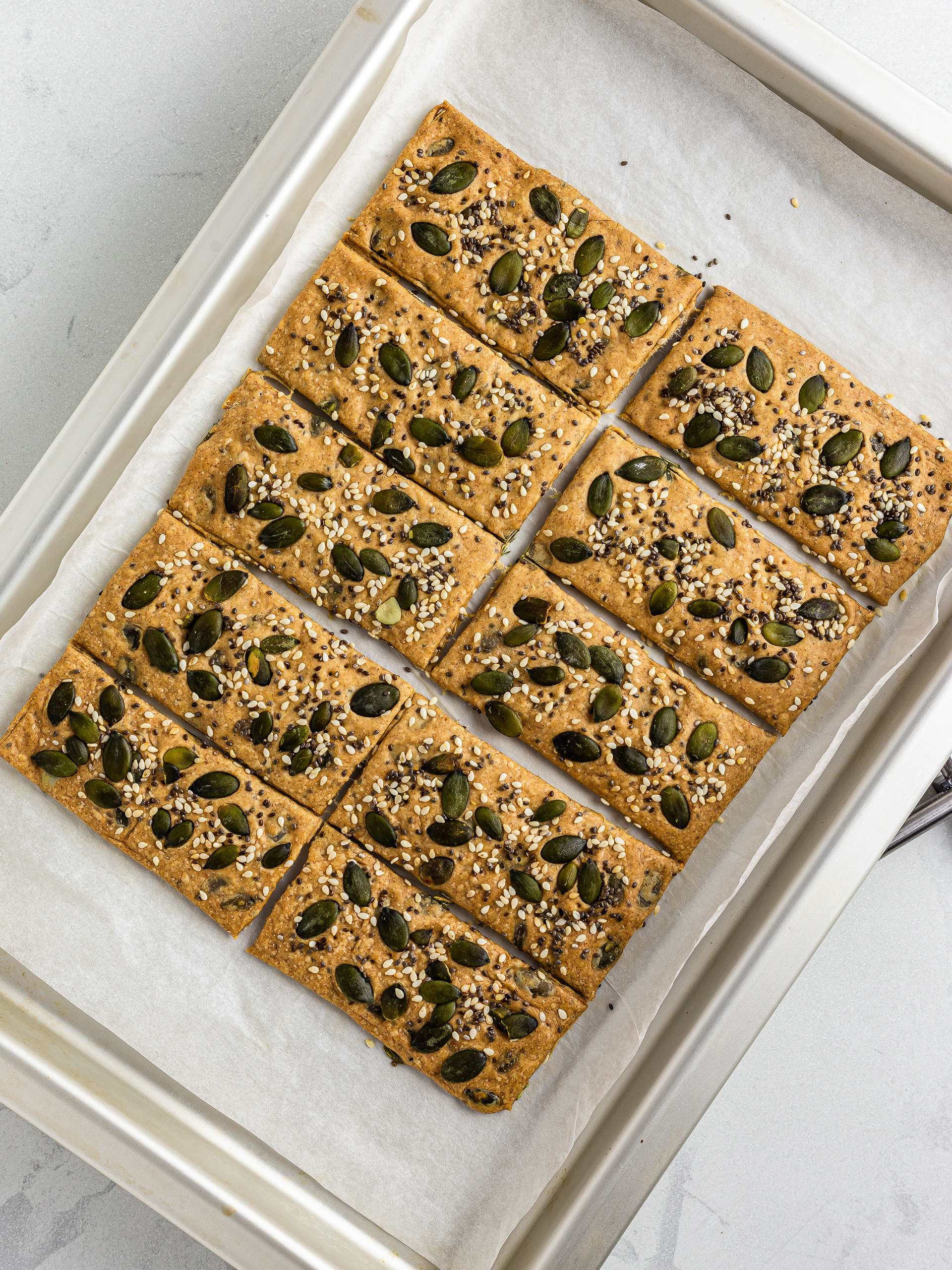 oven-baked spelt crackers on a baking tray